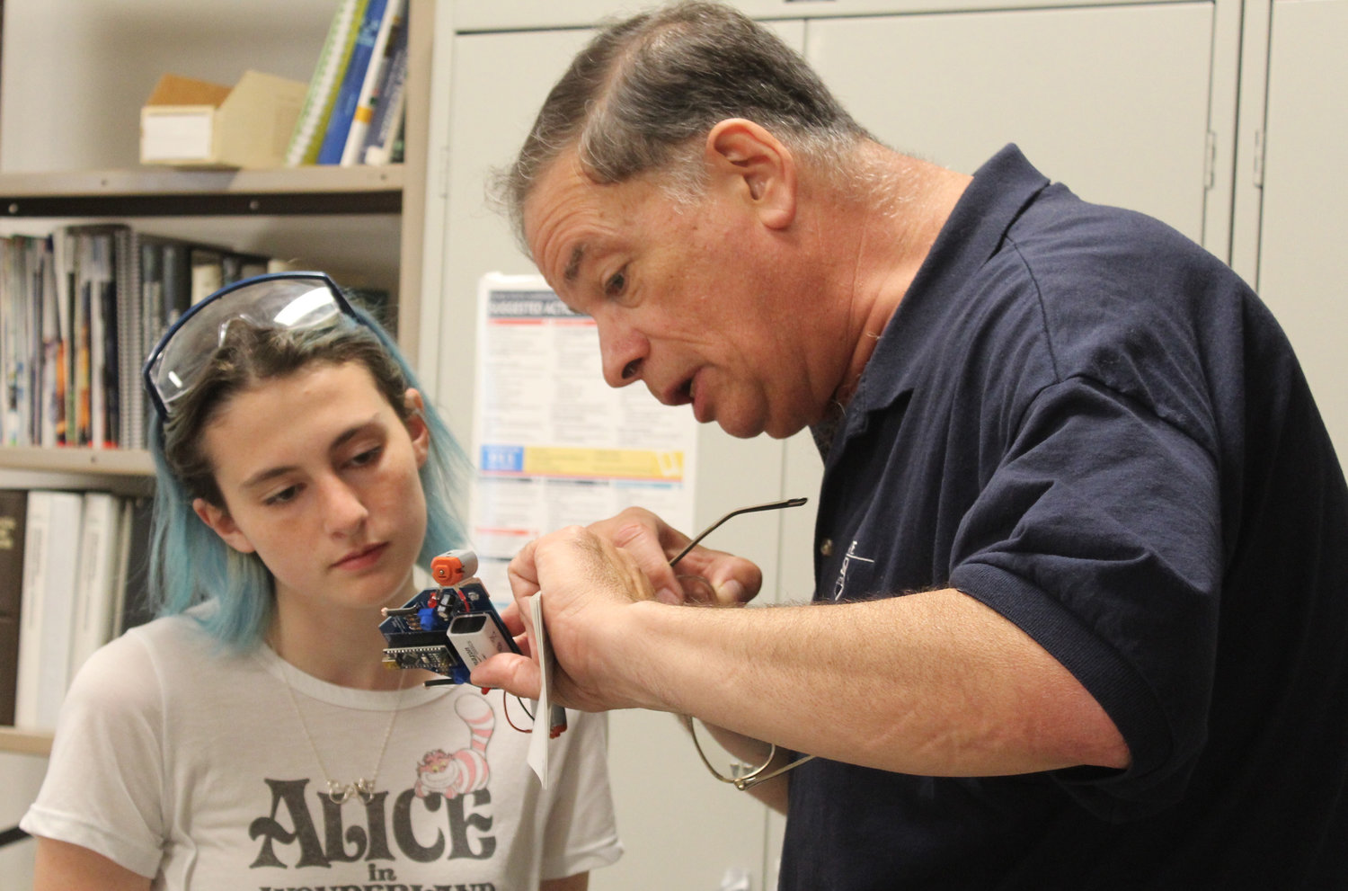 Seth Wolpert, Associate Professor of Electrical Engineering, School of Science, Engineering, and Technology, works with Lower Dauphin student Sierra Endy during Penn State Harrisburg's STEM Summer Enrichment Program's electrical engineering lab on June 19.
