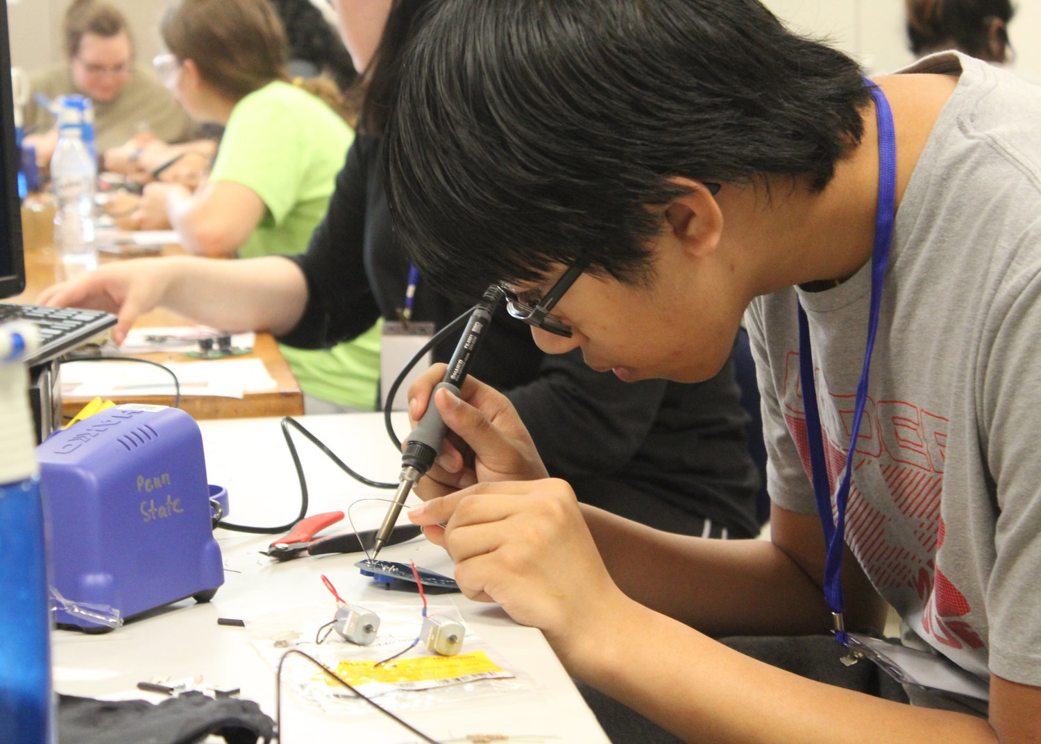 Hershey High School student Luke Wang solders during the electrical engineering lab during Penn State Harrisburg's STEM Summer Enrichment Program on June 19.