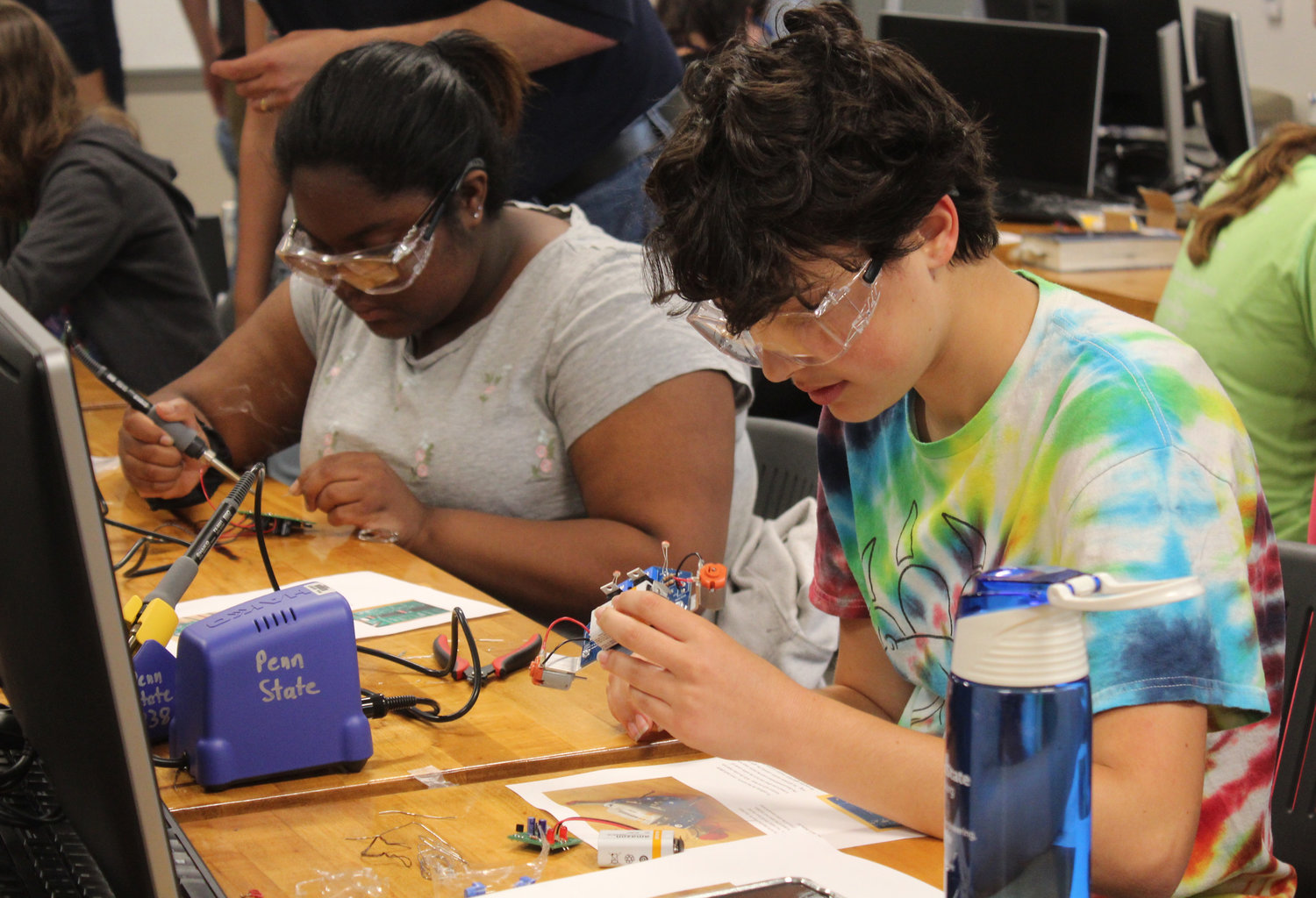 Harrisburg Academy student Linsai Jackson and Central Dauphin student Callie Ritter work during the electrical engineering lab during Penn State Harrisburg's STEM Summer Enrichment Program on June 19.