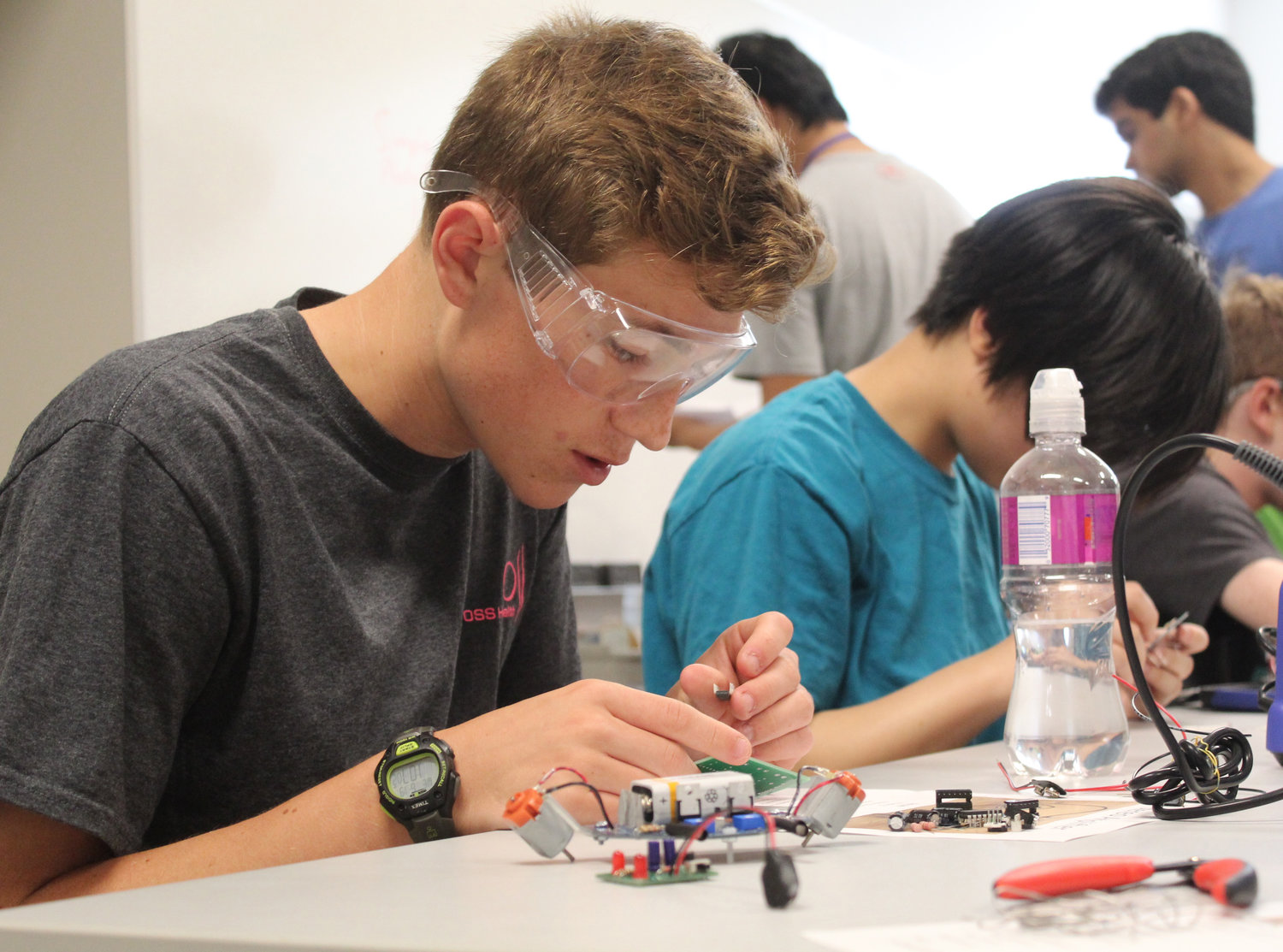 Cumberland Valley High School's Max Miller works on a circuit board during the electrical engineering lab during Penn State Harrisburg's STEM Summer Enrichment Program on June 19.