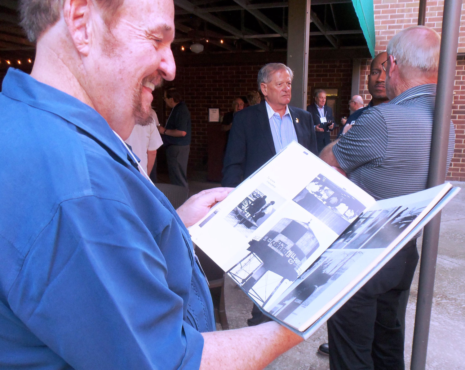 PSU Capitol Campus graduate John Larkin browses through a campus yearbook from 1969, the year he graduated.
