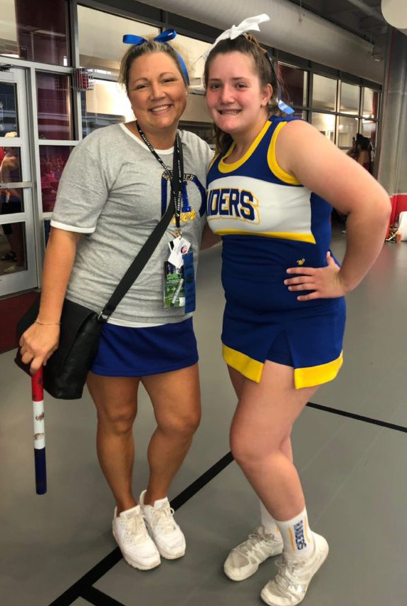 Middletown Area High School cheerleaders recently took part in a National Cheerleaders Association camp at Shippensburg University. Head coach Jessica Welsh and Emma Mitchell enjoy the event.