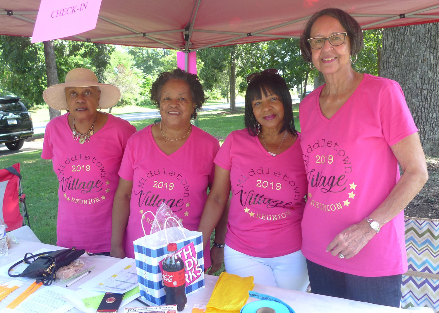 Signing people in at the second annual Middletown Village Reunion on Saturday at Hoffer Park are Brenda Thomas (Folks), Harriet Baylor (Crisp), Wanda Jefferies and Emma Pettis (Holton).