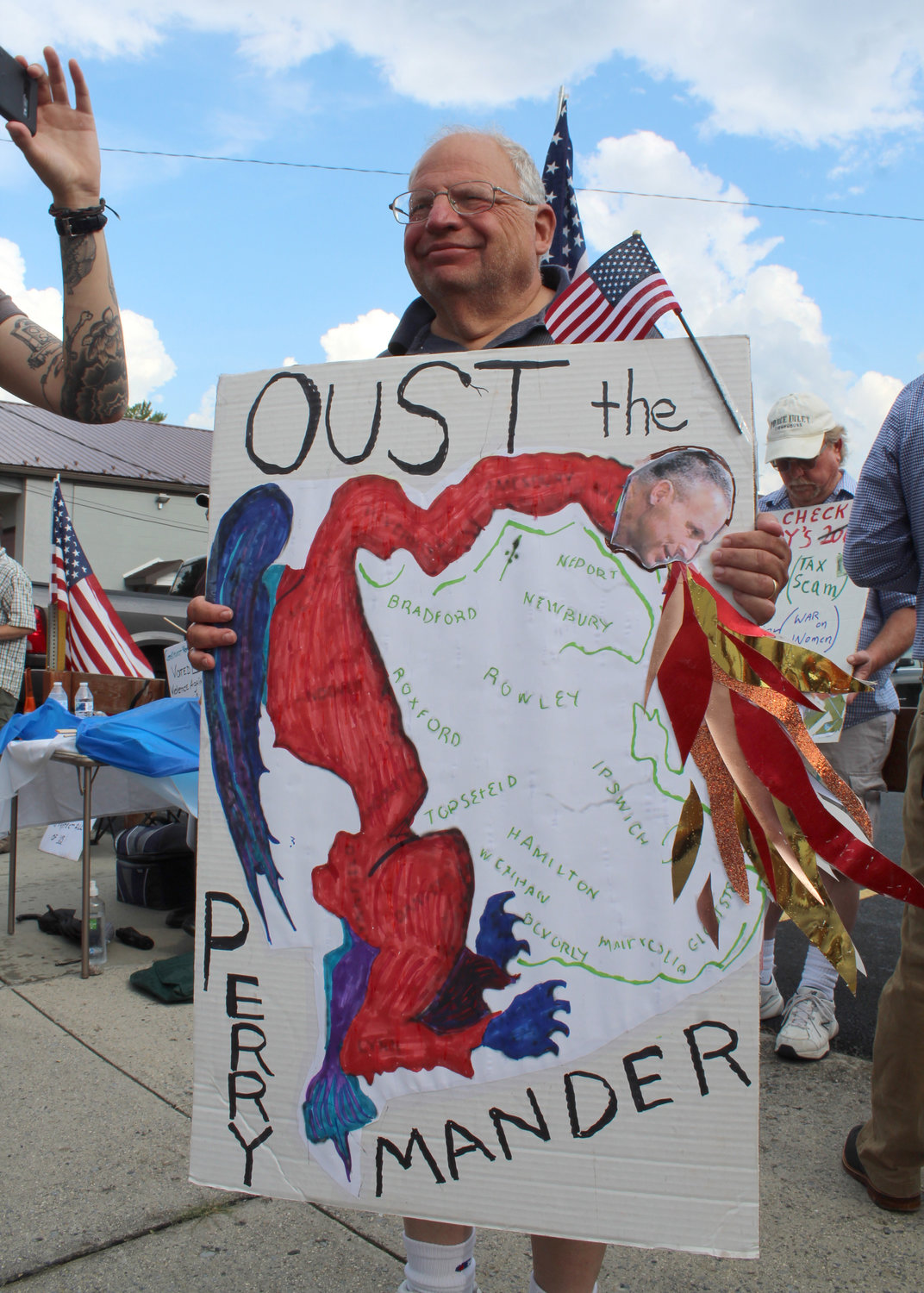 Rand Tenor, of Hampden Township, protests Congressman Scott Perry's town hall on July 30.