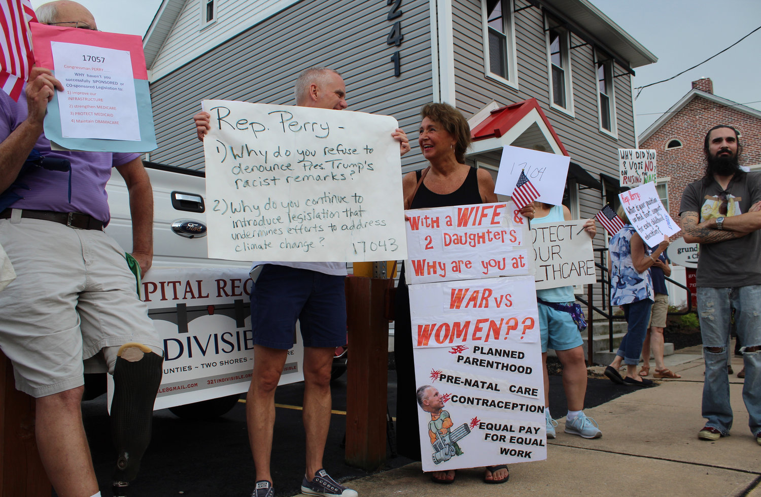 Protesters lined up in front of the Hummelstown Fire Department to protest Congressman Scott Perry's town hall on July 30.
