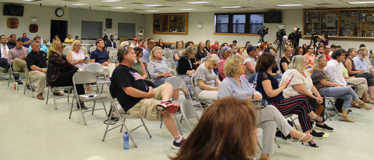 About half of the 118 chairs in the Hummelstown Fire Department were filled when Congressman Scott Perry started his town hall event on July 30.