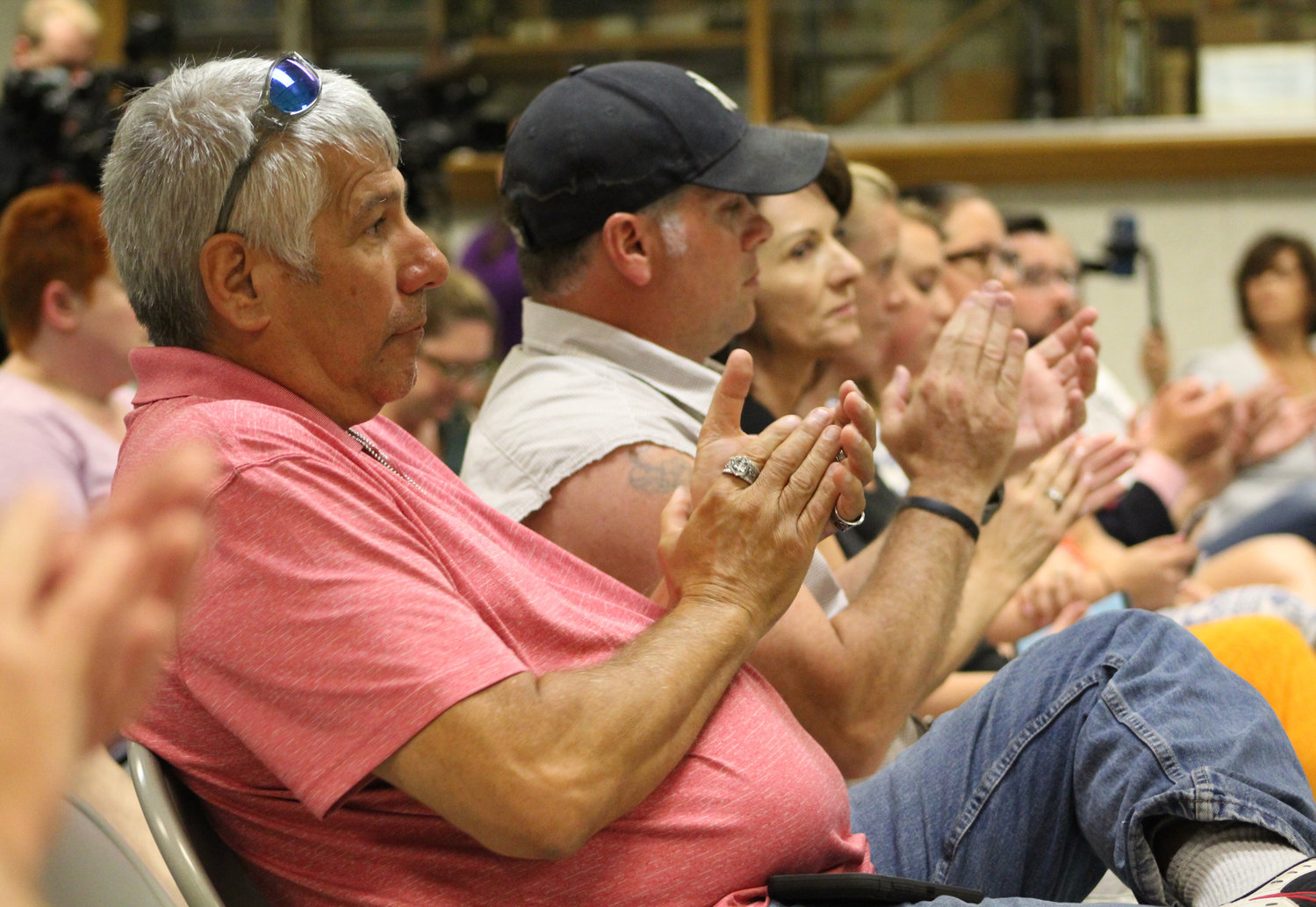 Robert Hirsch, of Carlisle, applauds during Congressman Scott Perry's town hall at the Hummelstown Fire Department on July 30.