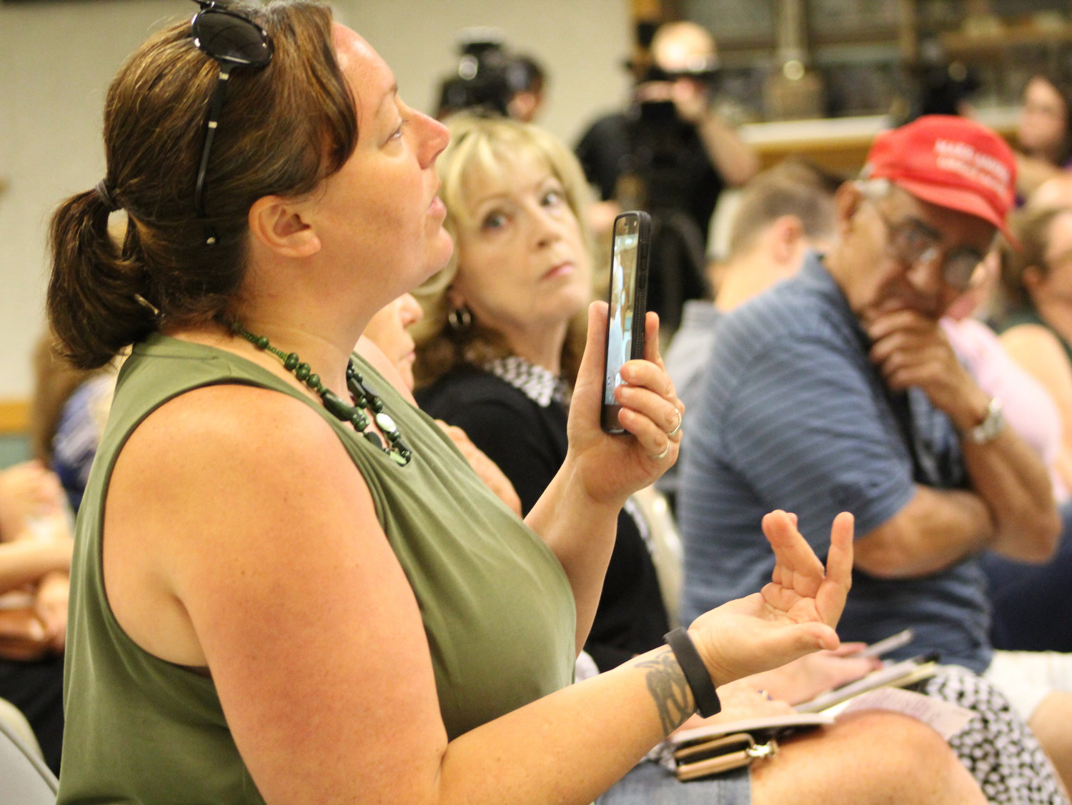 Tracy Brown, of Hershey, asks Congressman Scott Perry a question during his town hall at the Hummelstown Fire Department on July 30.