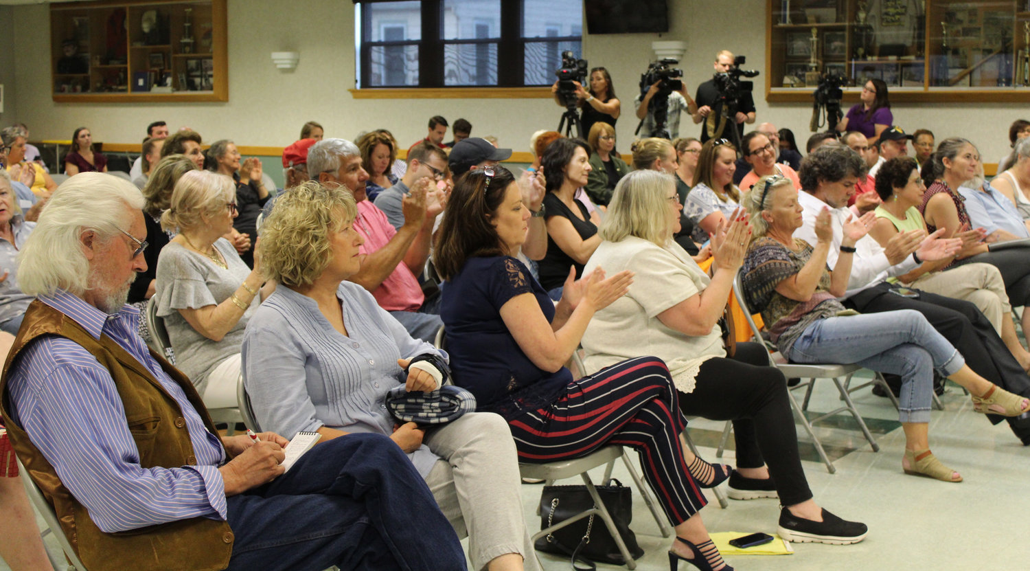 Some audience members applaud during Congressman Scott Perry's town hall at the Hummelstown Fire Department on July 30.