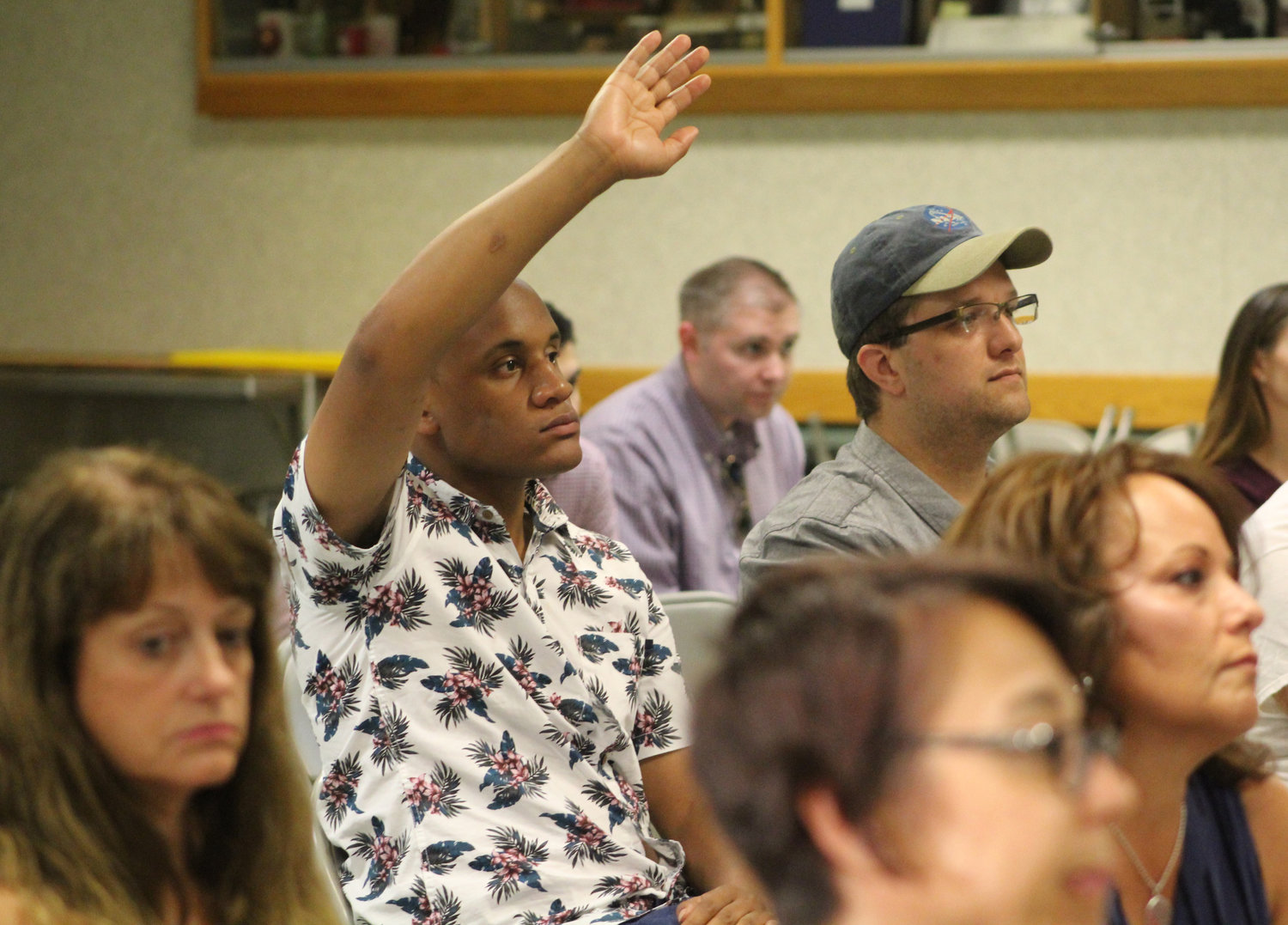 Cole Goodman, of Susquehanna Township, raises his hand during Congressman Scott Perry's town hall at the Hummelstown Fire Department on July 30. Goodman told the Press & Journal that he was allowed into the town hall about three-fourths of the way through the event.