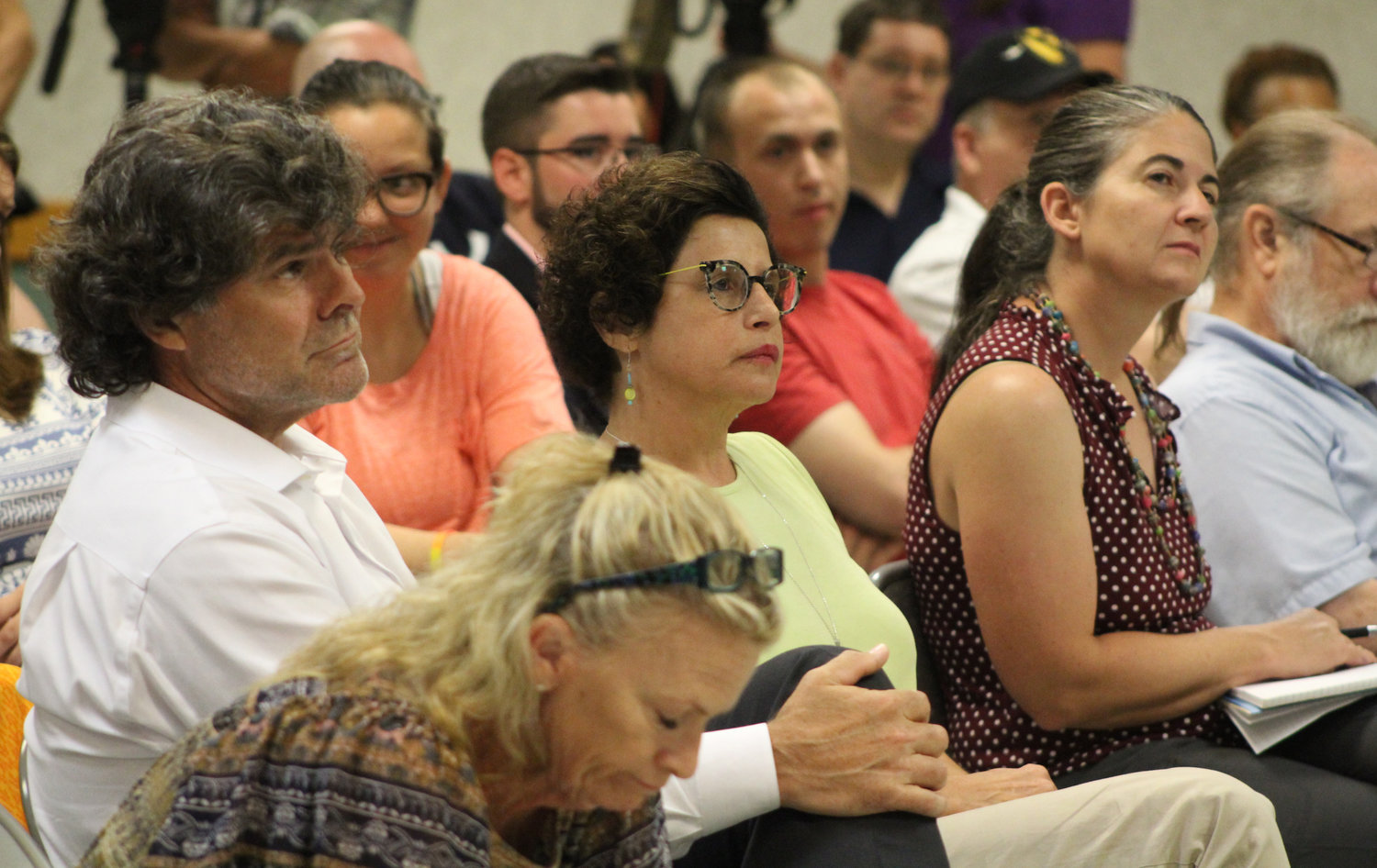 Lower Paxton resident Carolyn Wolf, center, listens to Congressman Scott Perry during his town hall at the Hummelstown Fire Department on July 30.