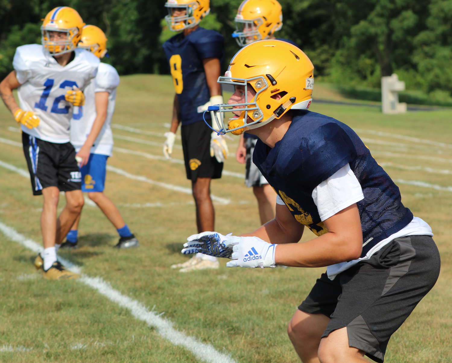 Dylon Zettlemoyer prepares to catch the ball during heat acclimatization on Aug. 5.