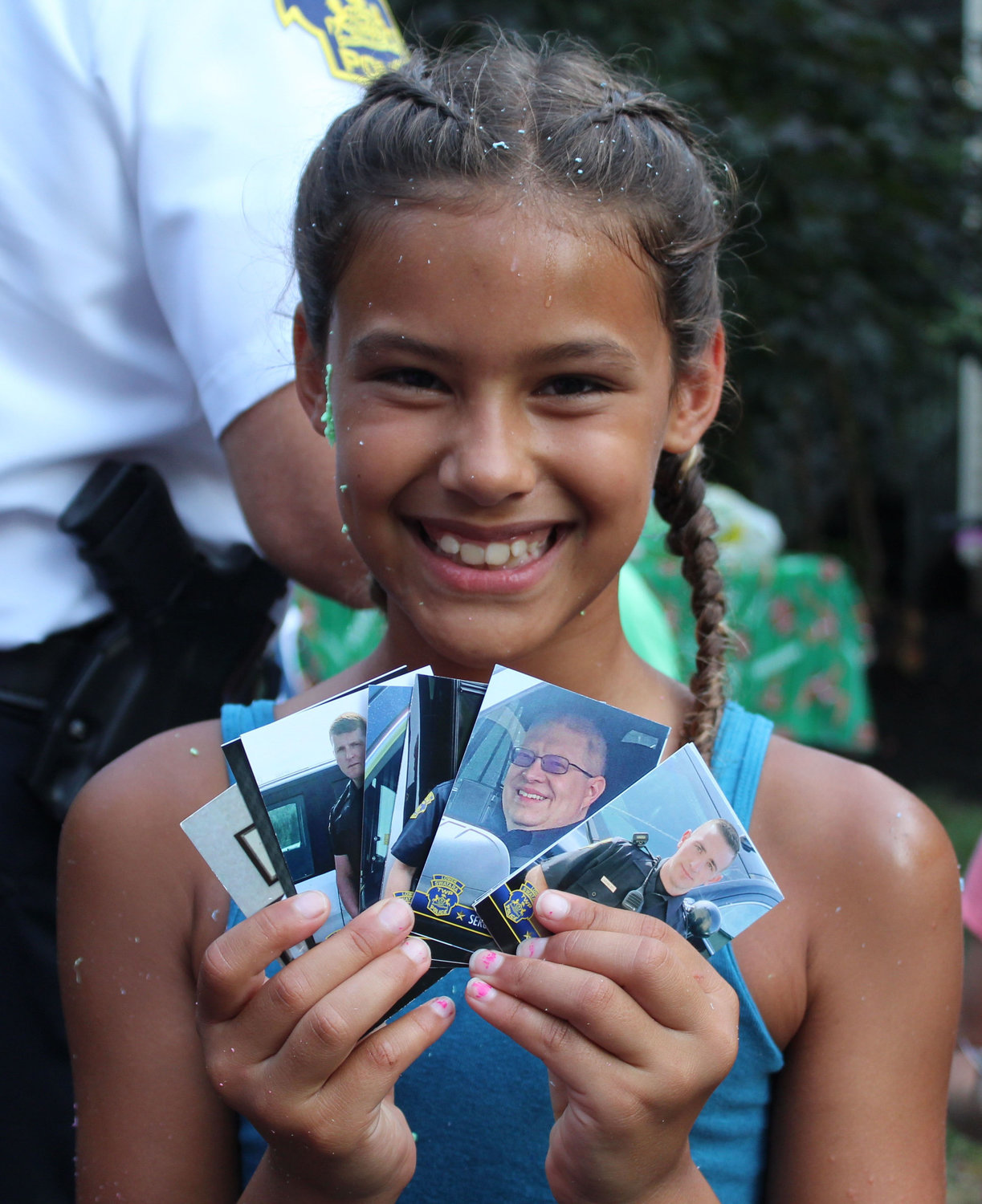 Safia Aman has collected almost all of the Lower Swatara police officers' baseball cards and showed them off during National Night Out in Lower Swatara on Aug. 6.