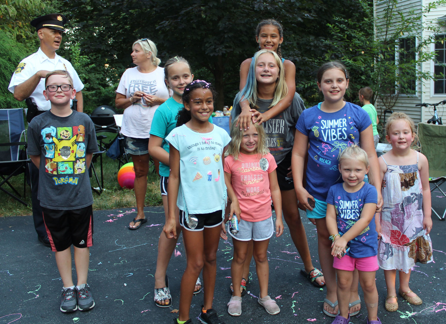 Gabriel Shaver, Kiersten Roller, Gabby Romain, Lucy Stevenson, Riley Stevenson, Safia Aman (on back), Olivia Miller, Rylee Miller, and Madelynn Shaver play during National Night Out in Lower Swatara on Aug. 6.