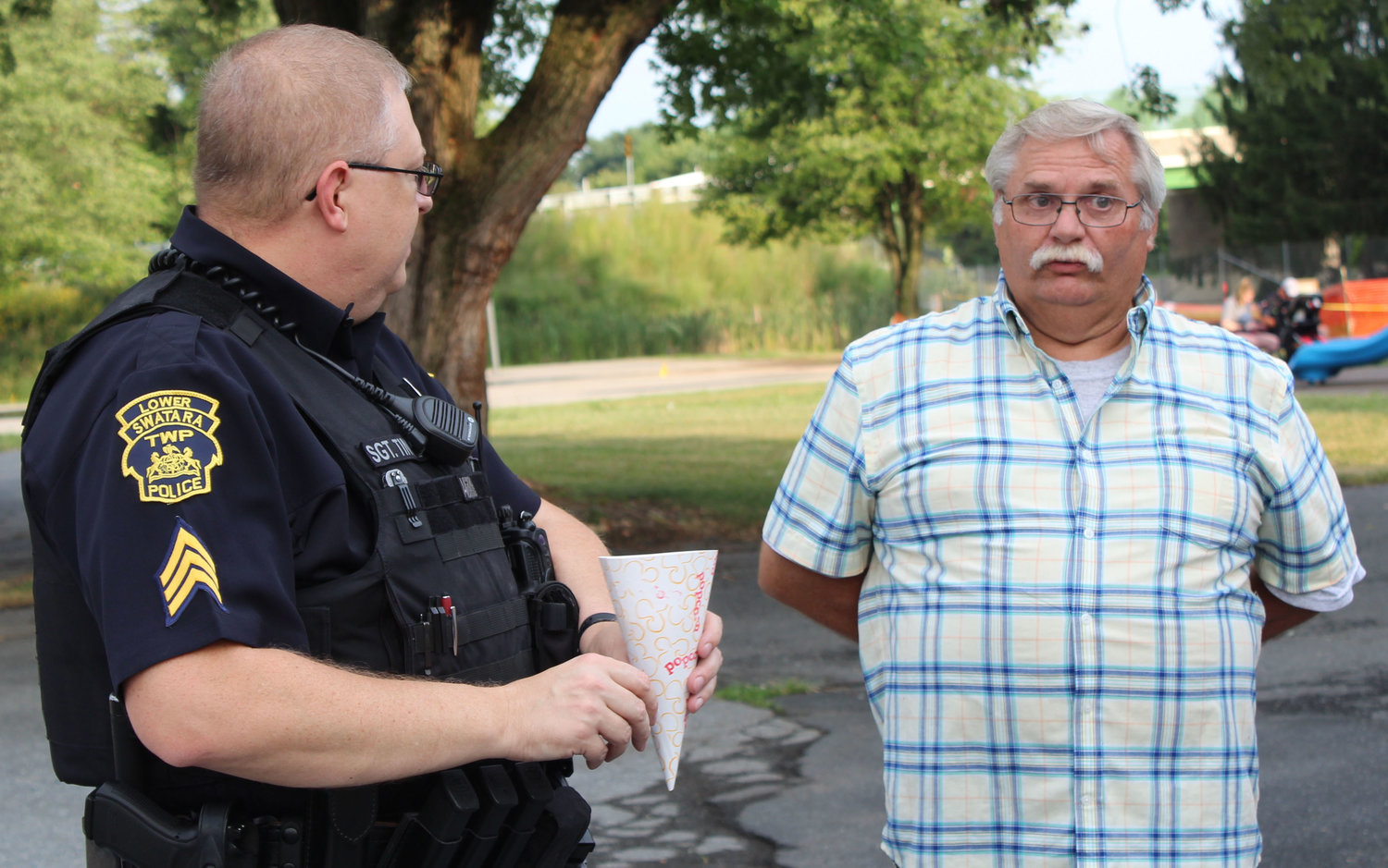 Sgt. Dan Tingle talks with Curt Zeiders during National Night Out in Lower Swatara on Aug. 6.