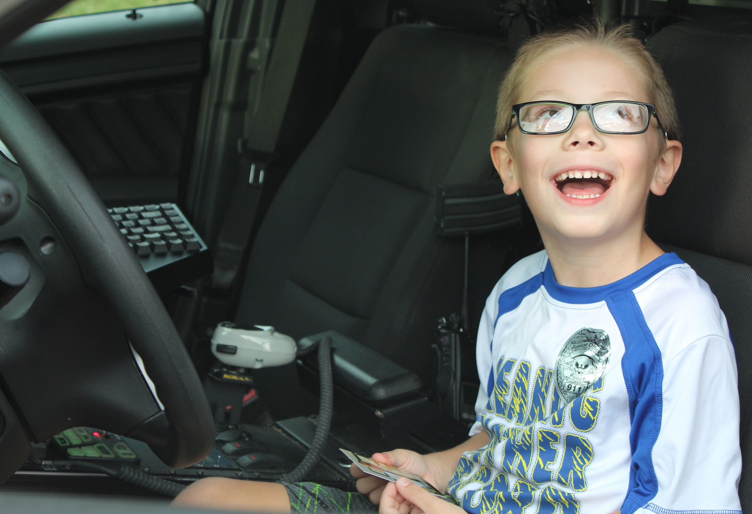 Corsair Billy is all smiles after Lower Swatara Police Chief Jeff Vargo lets him sit in his patrol car during National Night Out on Aug. 6.
