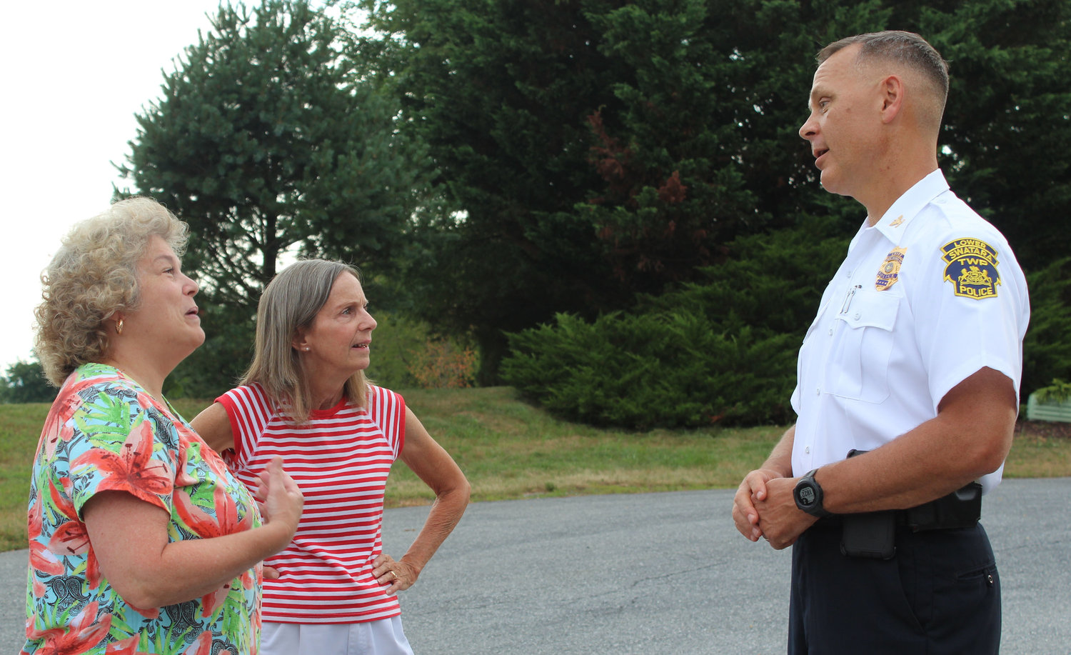 Wendy Kauffman and Rose Walker talk with Lower Swatara Police Chief Jeff Vargo during National Night Out Aug. 6.