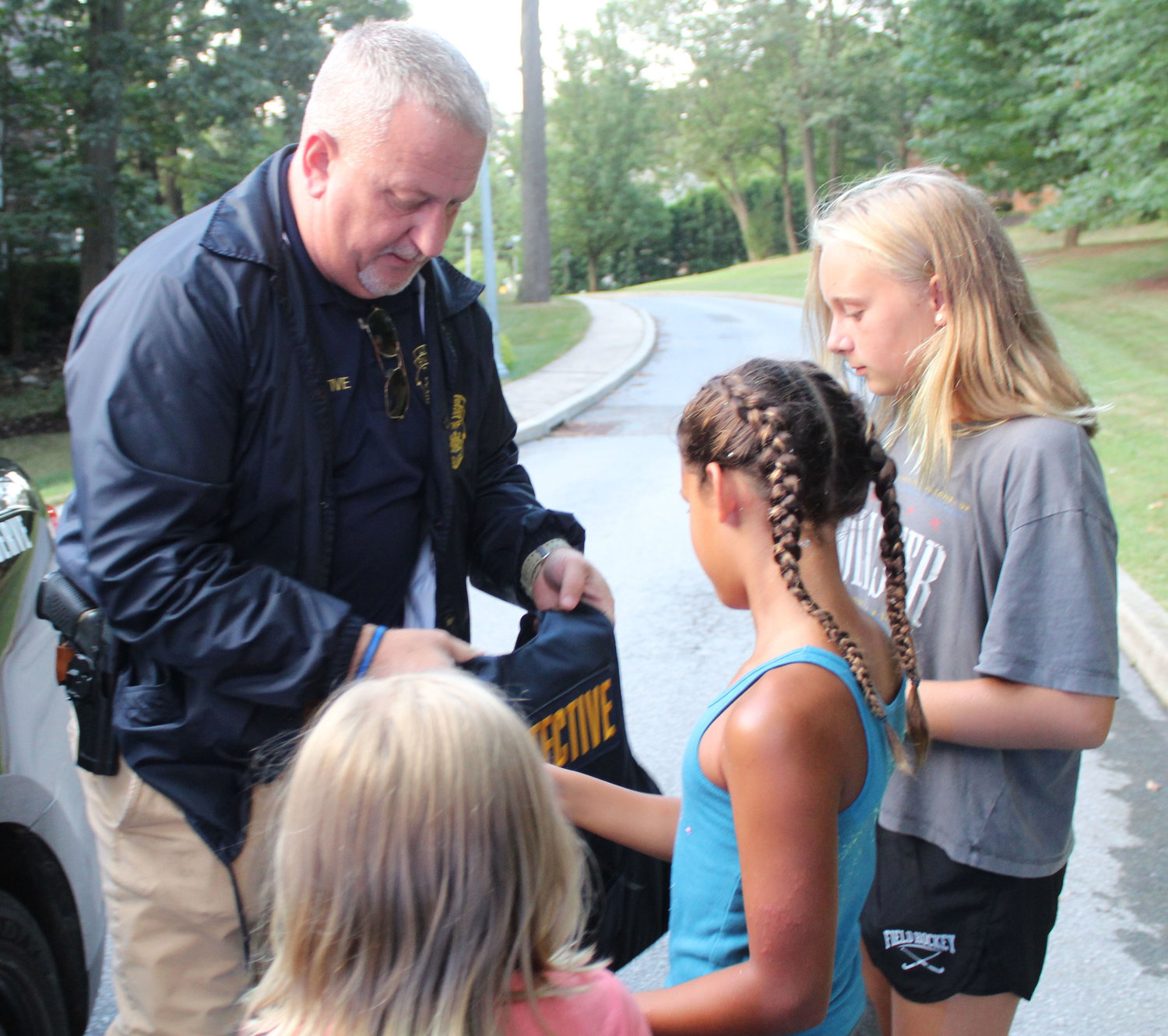 Detective Bob Appleby let kids hold his vest during National Night Out in Lower Swatara on Aug. 6.