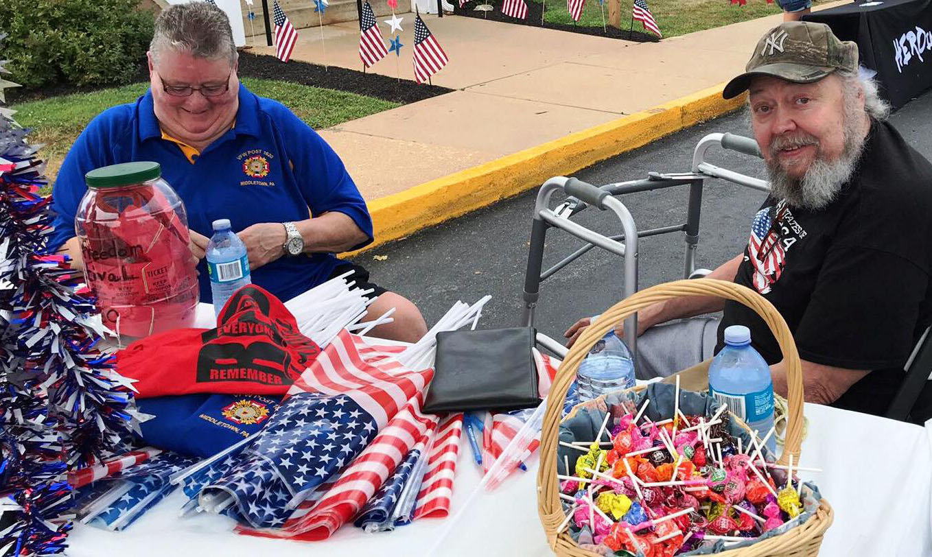 Middletown VFW Post No. 1620 veterans Sis Leeper, left, and Steve Sellers welcomed visitors to the first Freedom Community Festival on Aug. 17. The event was organized by the VFW Post No. 1620 Auxiliary.