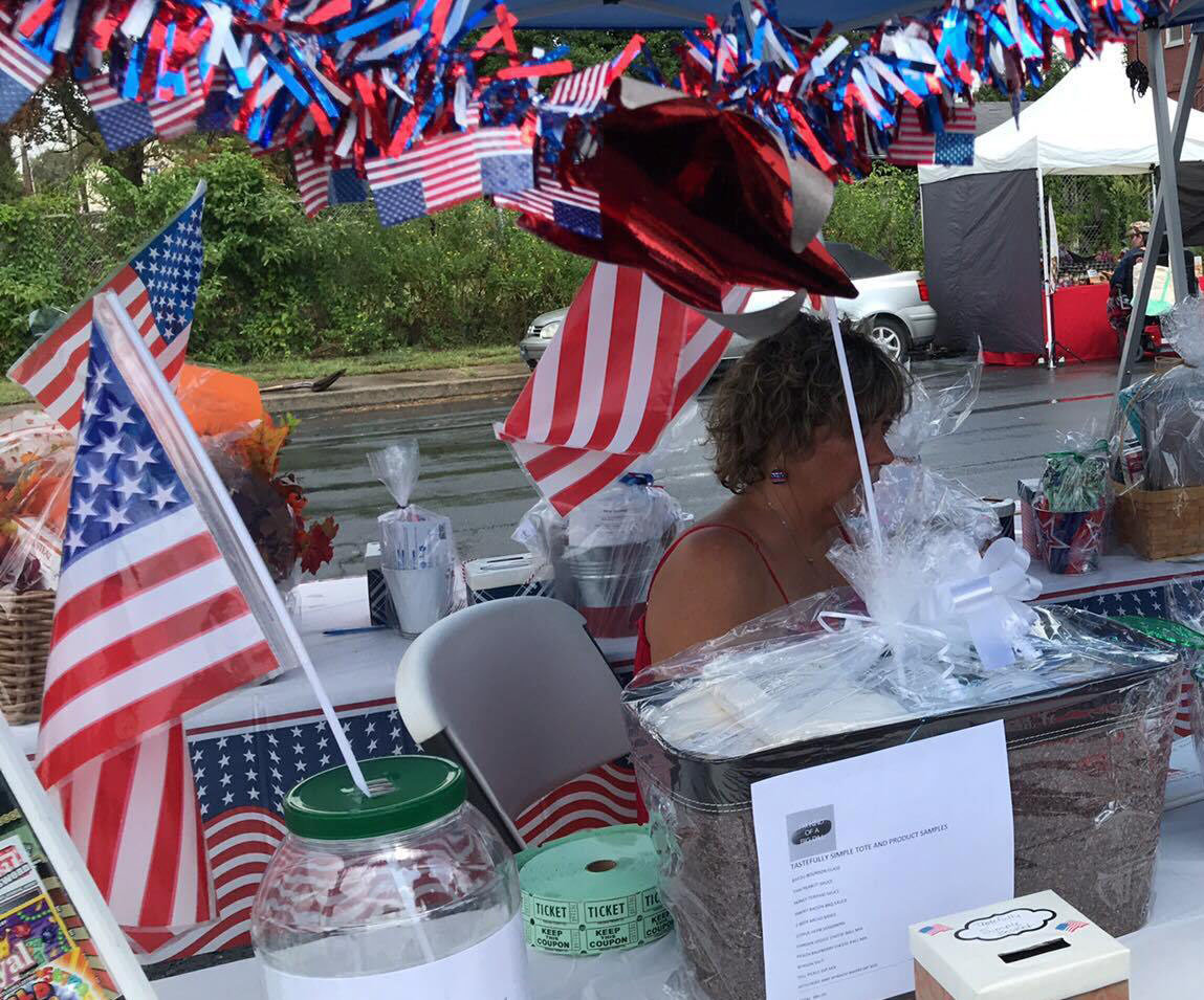 Tina Cobaugh of Middletown VFW Post No. 1620 Auxiliary is surrounded by the red, white and blue at the auxiliary's first Freedom Community Festival on Aug. 17. Cobaugh headed the auxiliary committee that organized the event.