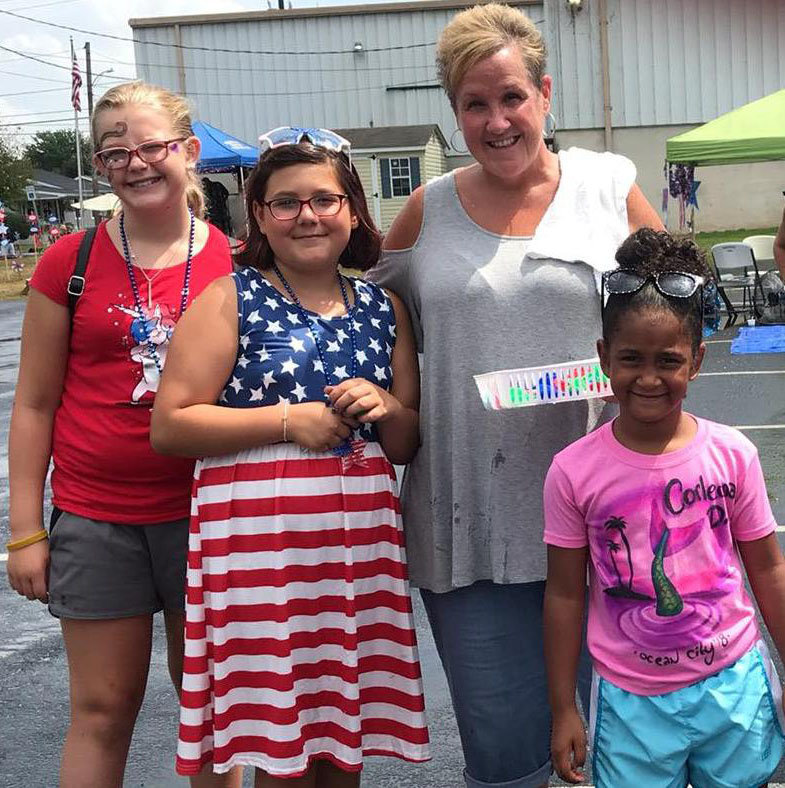 Ariya Womelsdorf, 11, of Duncannon; Deziree Brubaker, 11, of Port Royal; Lisa Vega of Middletown VFW Post No. 1620 Auxiliary; and Corleona Drayton, 5, of Middletown, are ready for fun at the Freedom Community Festival on Aug. 17.