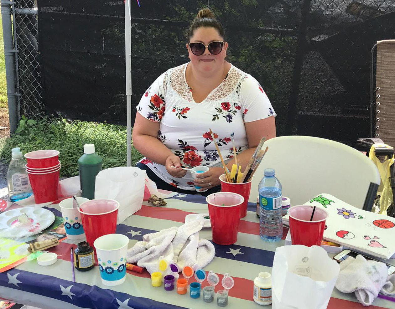 Sarah Cooper, an instructor at Commonwealth Charter Academy in Harrisburg, volunteered as a face-paint artist at the first Freedom Community Festival held by Middletown VFW Post No. 1620 Auxilliary on Aug. 17.