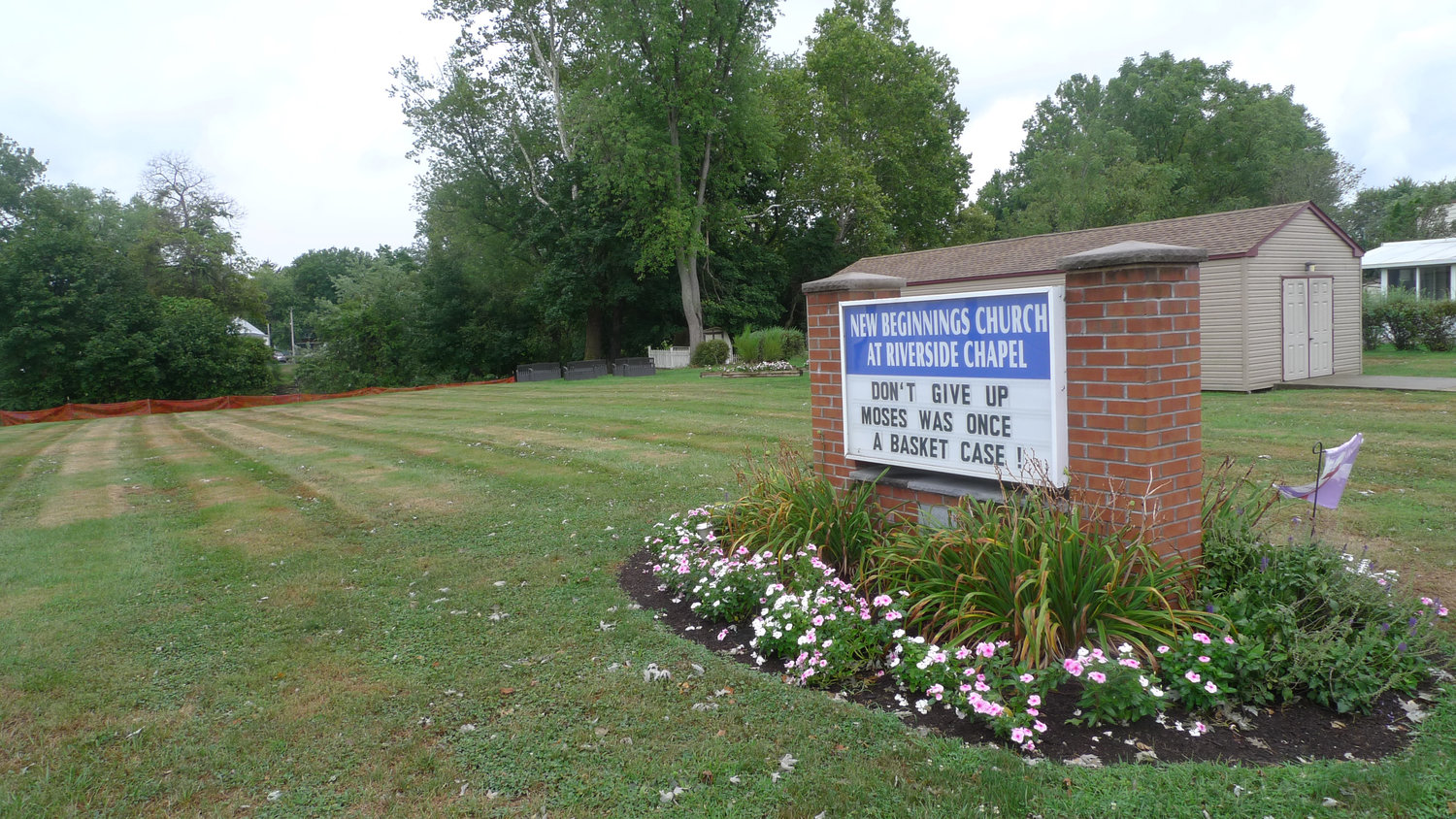 The black benches to the left of this sign are where the cross was located on the grounds of the New Beginnings Church at 630 S. Union St. in Middletown.