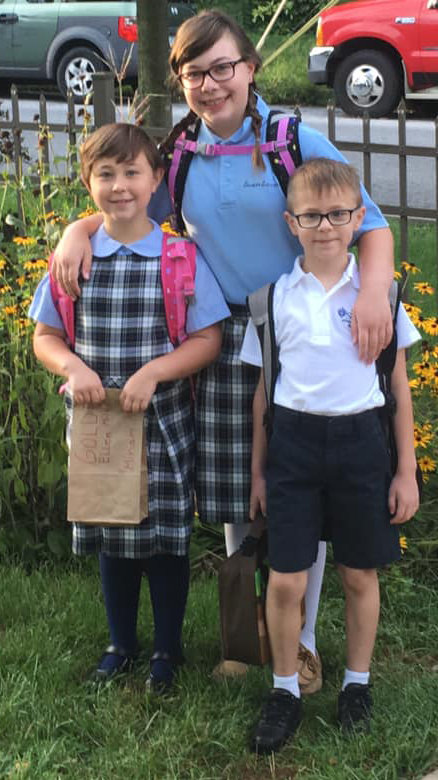 Felicity Astfalk, sixth grade, Miriam Astfalk, second grade, and Jacob Astfalk, first grade, Seven Sorrows