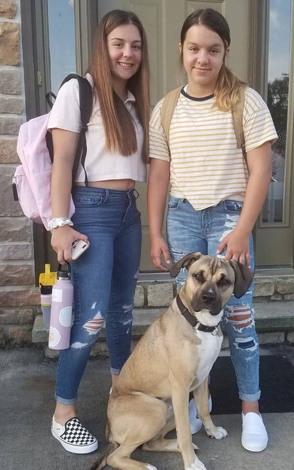 Maddy White, sophomore, Middletown Area High School, and Chloe White, seventh grade, Middletown Area Middle School, along with Rocco, 11 months.