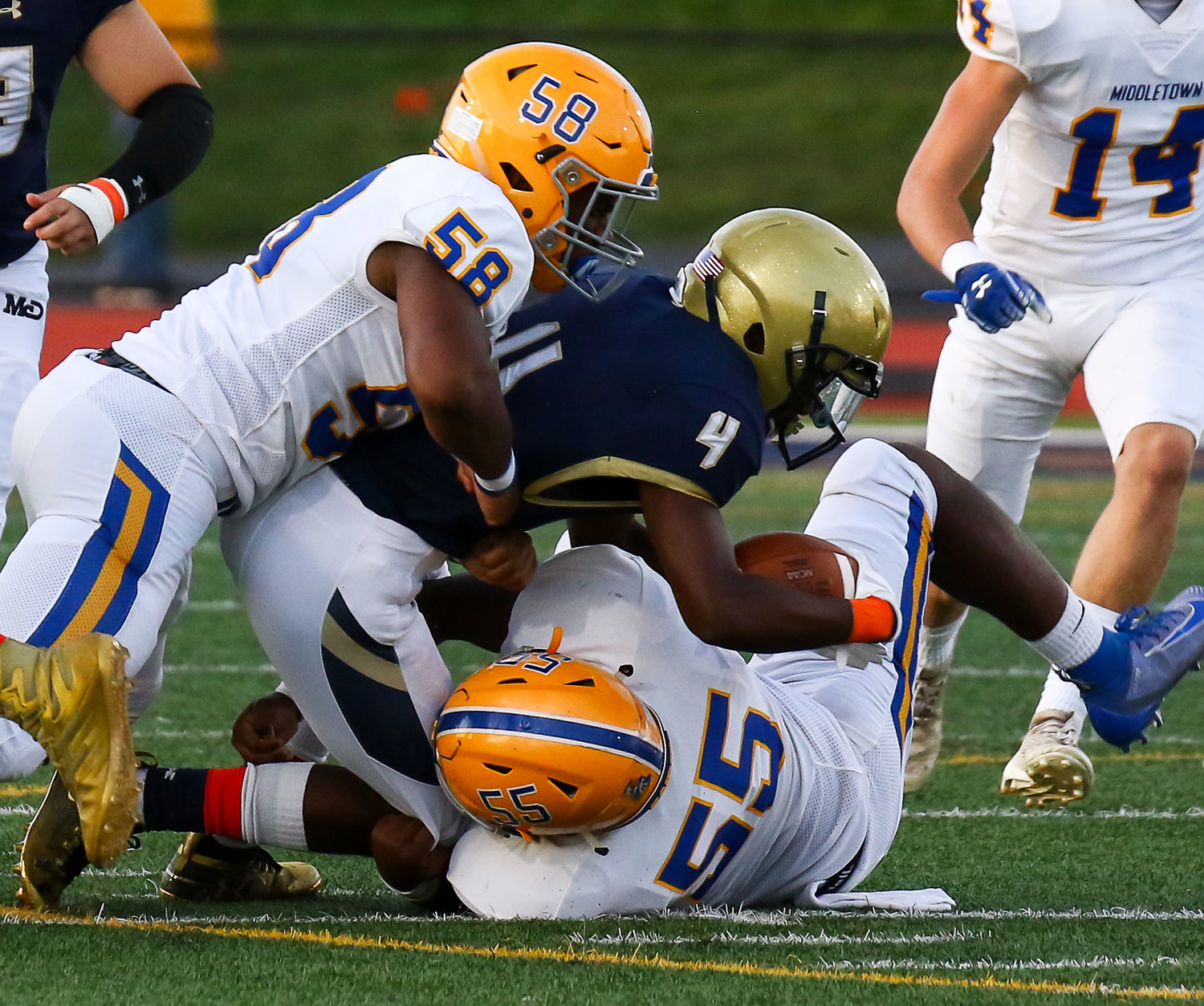 No. 58 Arthur Dash and No. 55 Jeremy Wells tackle the Bishop McDevitt ball carrier Sept. 6 in the Blue Raiders 6-2 win.