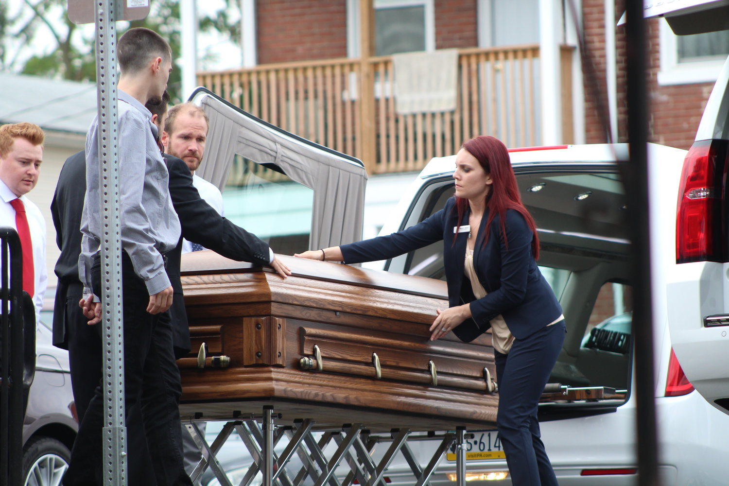 Torin Dworchak's casket is placed in a hearse outside St. Peter's Evangelical Lutheran Church on Sept. 16.