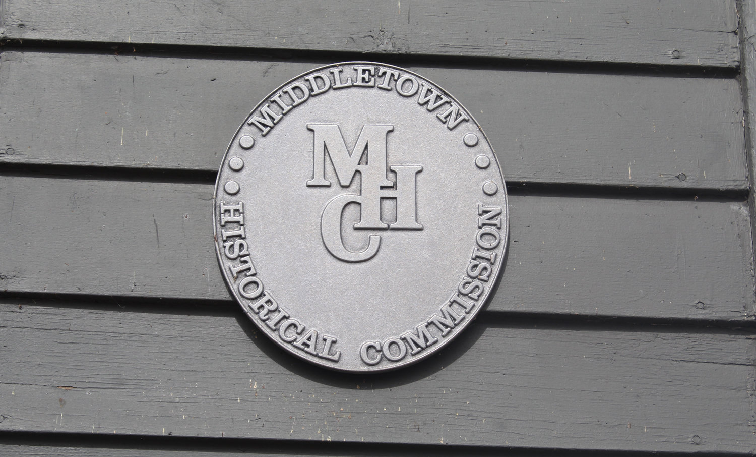 A plaque on the front of the Middletown Area Historical Society is an example of what the Historical Restoration Commission places on buildings.