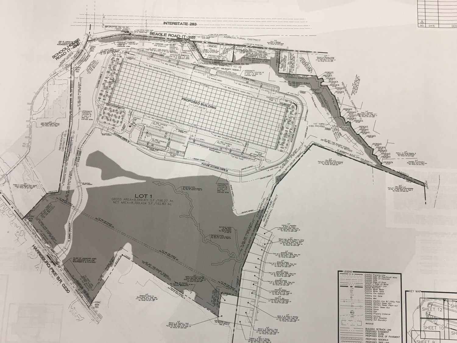 This image from the land development plan submitted by Core5 shows a proposed 1.2 million-square-foot warehouse on a 196-acre site behind Saturday's Market. Route 230 is in the southwest corner, and Beagle Road is to the north. The cut-out square at the bottom is Saturday's Market. The gray area indicates existing trees that will remain.