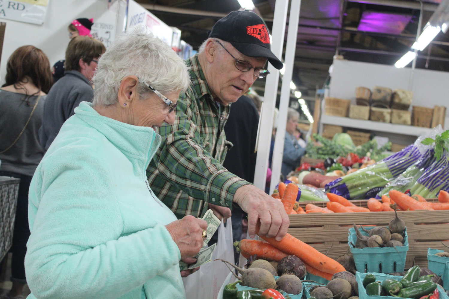 George and Joyce Whire purchase produce at a stall at Saturday's Market Oct. 12.