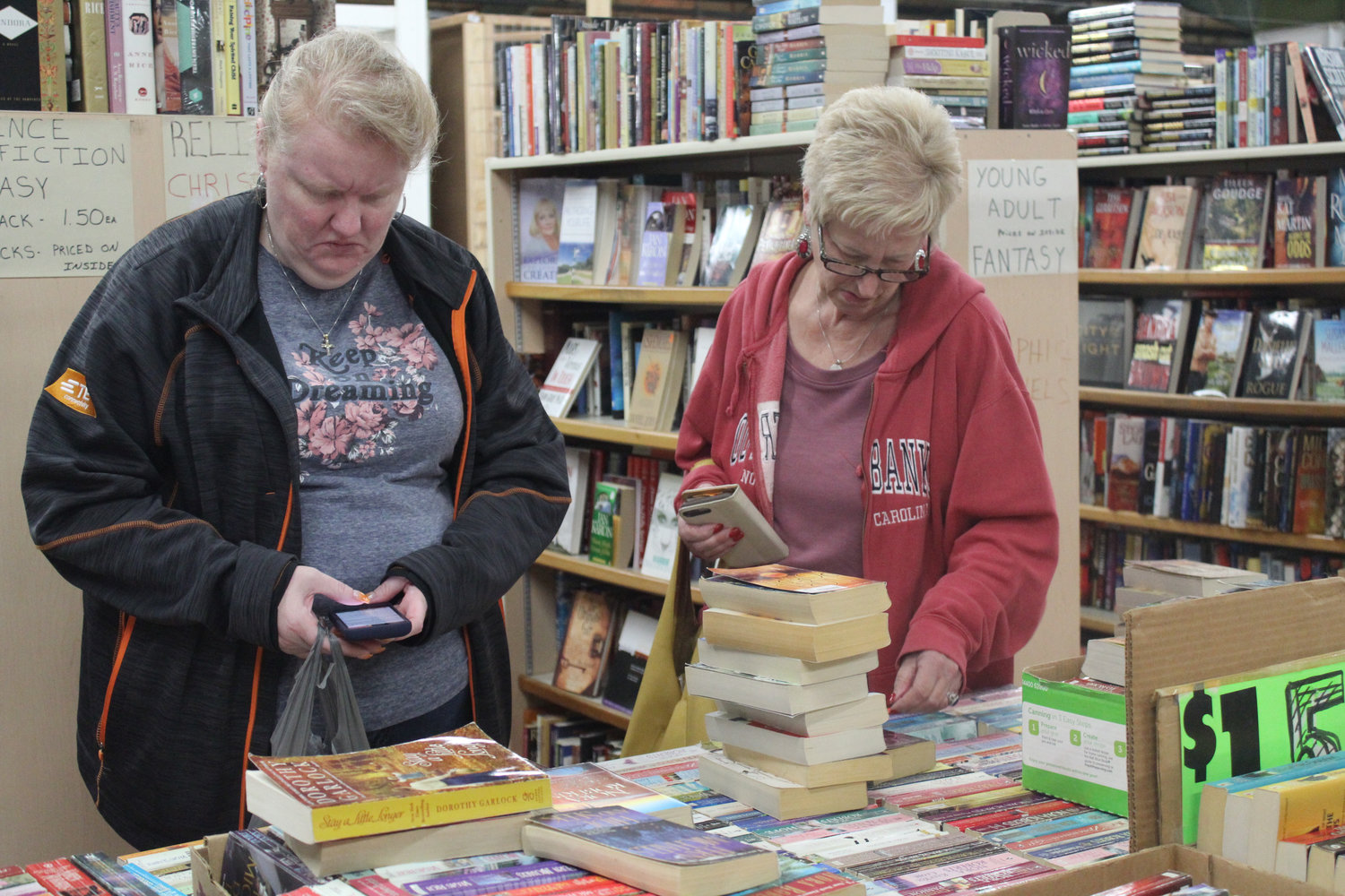 Cathi Bomberger and Deb Brown sort through books at Saturday's Market Oct. 12.