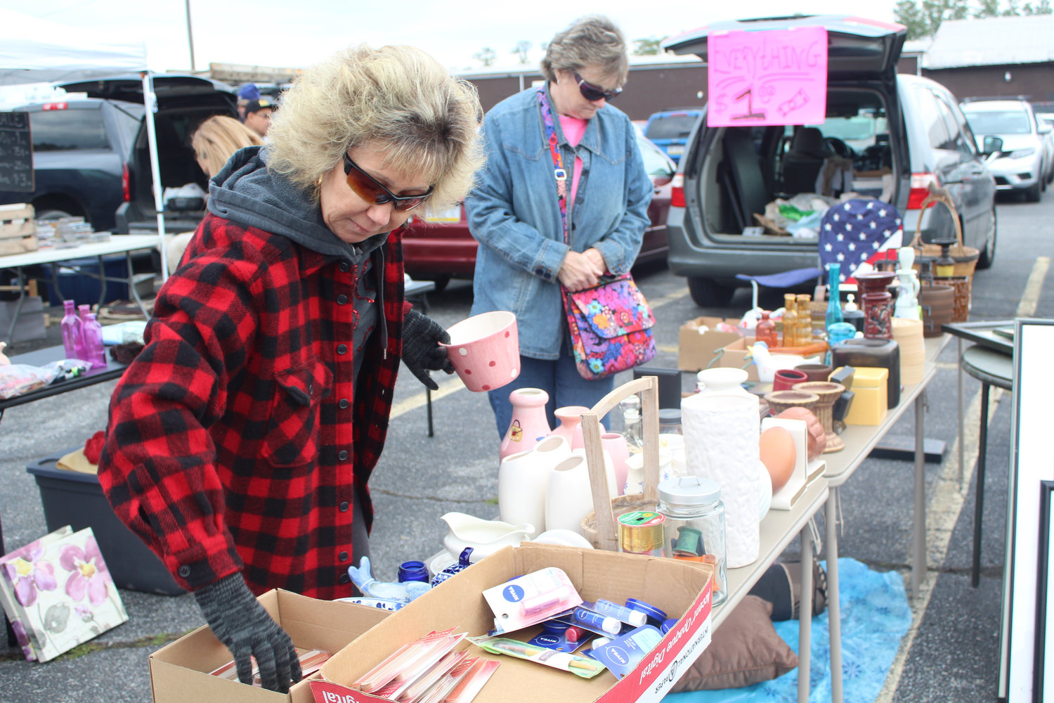 Kathy Ortega sorts through items in her stall at Saturday's Martket Oct. 12.