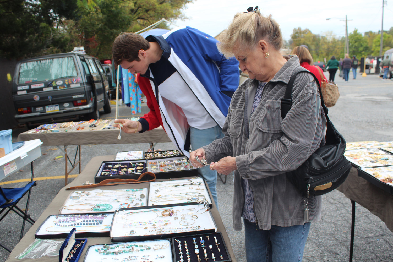 Donn Miller looks at a bracelet at Saturday's Market on Oct. 12.