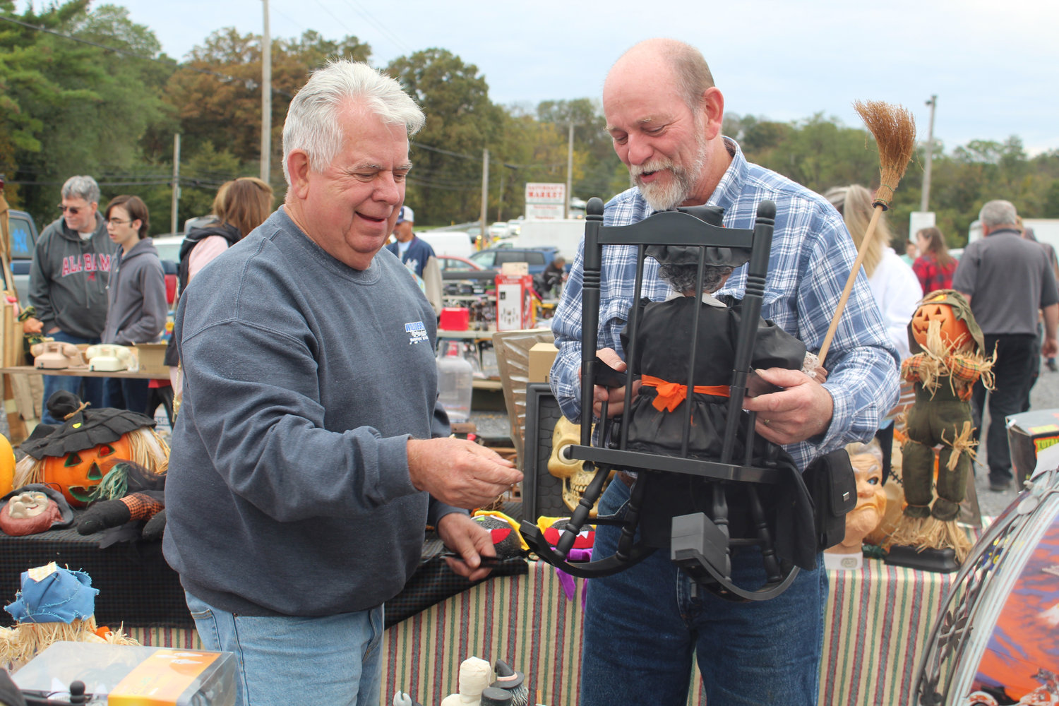Steve Burns (right) considers buying Garry Willders' Halloween decoration on sale at Saturday's Market Oct. 12.