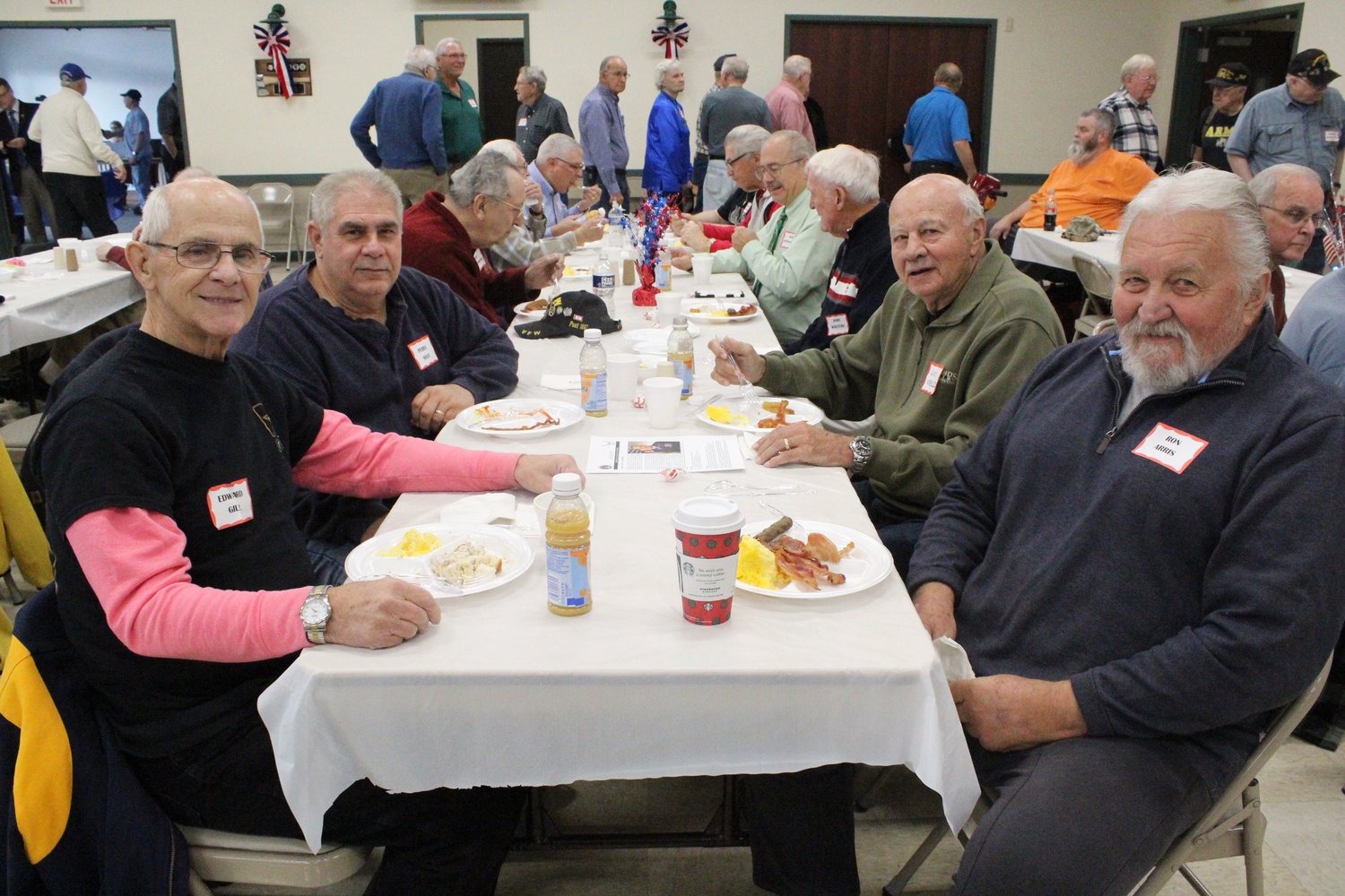 Navy and Army reserve veteran Edward Gill, Navy veteran Perry Sisti, Marine Corps veteran Ron Arris, and Army and Airforce veteran Louis Verdelli enjoy a meal during Rep. Tom Mehaffie's Veterans Breakfast at the Lower Swatara Fire Hall Nov. 8.
