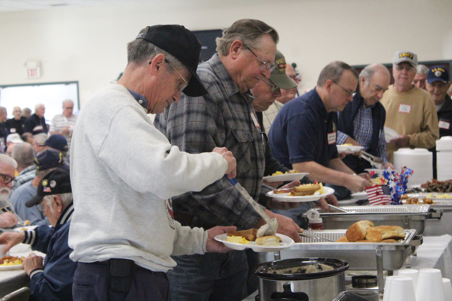 Marine Corps and National Guard veteran Larry Smith gets food during Rep. Tom Mehaffie's Veterans Breakfast at the Lower Swatara Fire Hall Nov. 8.