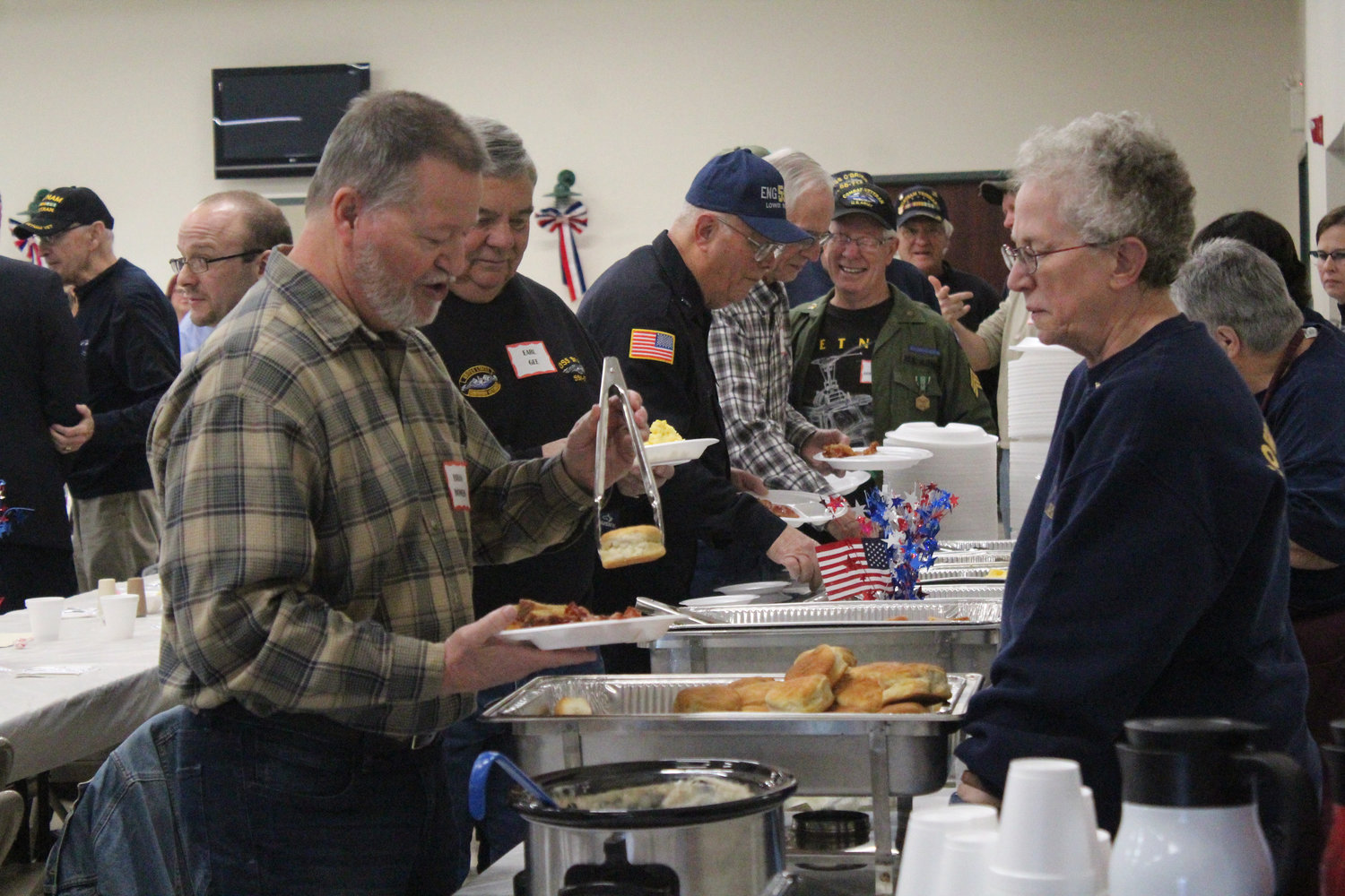 Navy veteran Brian Bowers fills his plate during Rep. Tom Mehaffie's Veterans Breakfast at the Lower Swatara Fire Hall Nov. 8.