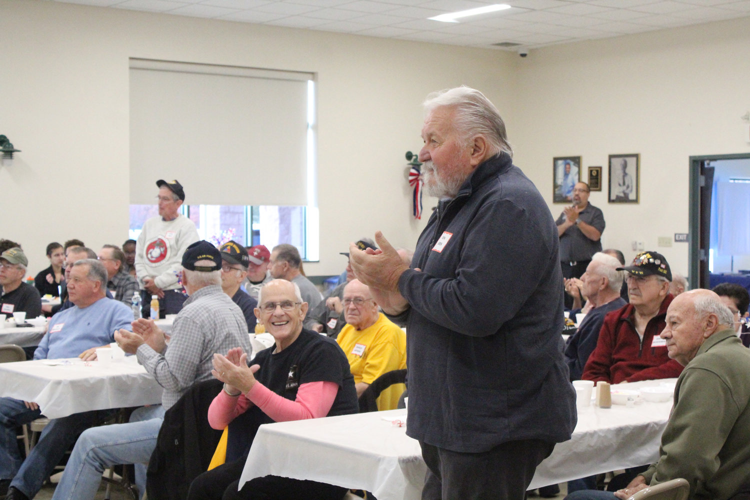 Marine Corps veteran Ron Arris stands as the marines are recognized during Rep. Tom Mehaffie's Veterans Breakfast at the Lower Swatara Fire Hall Nov. 8.