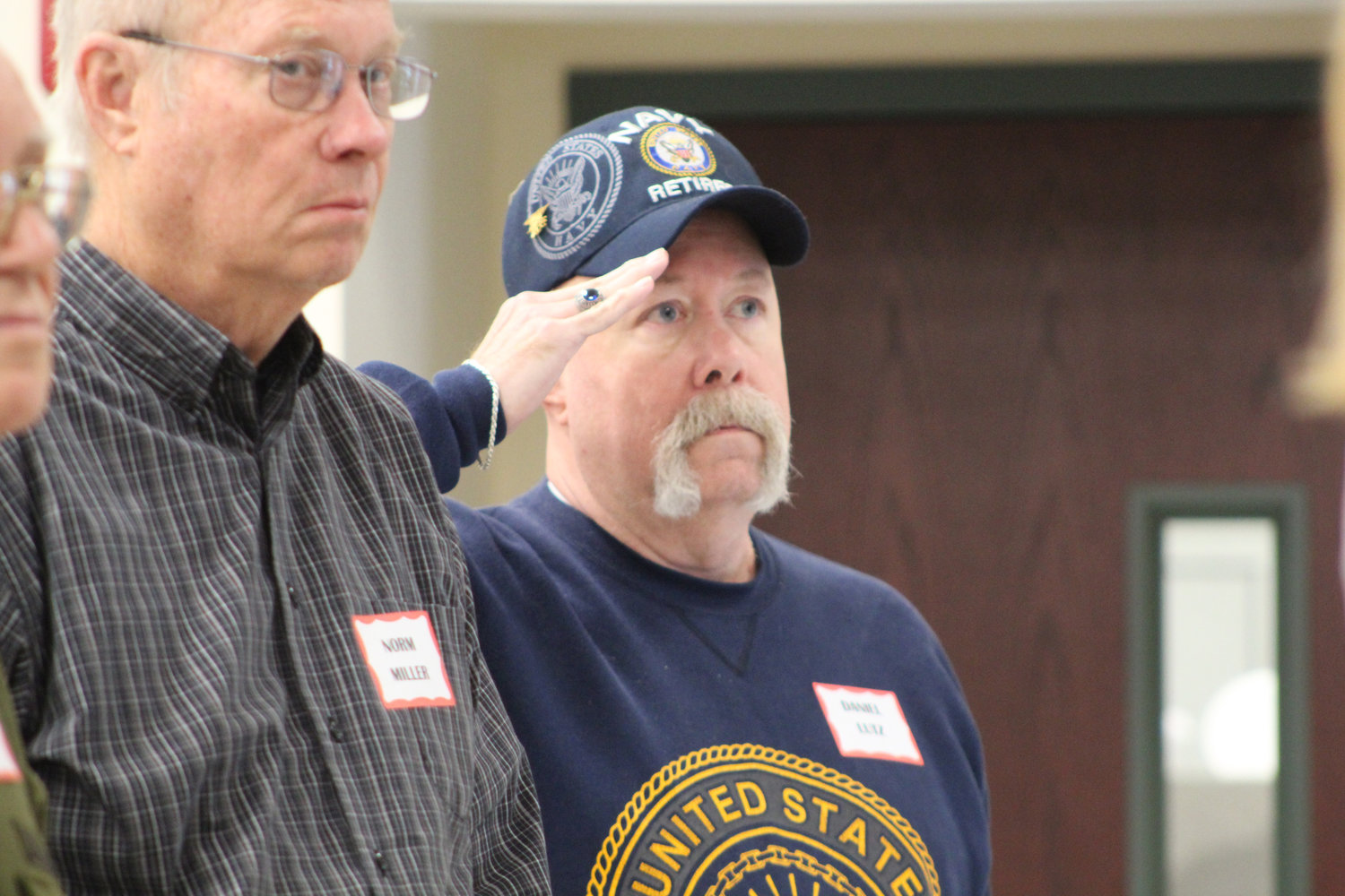Retired Navy Daniel Lutz salutes while the Star Spangled Banner is performed during Rep. Tom Mehaffie's Veterans Breakfast at the Lower Swatara Fire Hall Nov. 8.