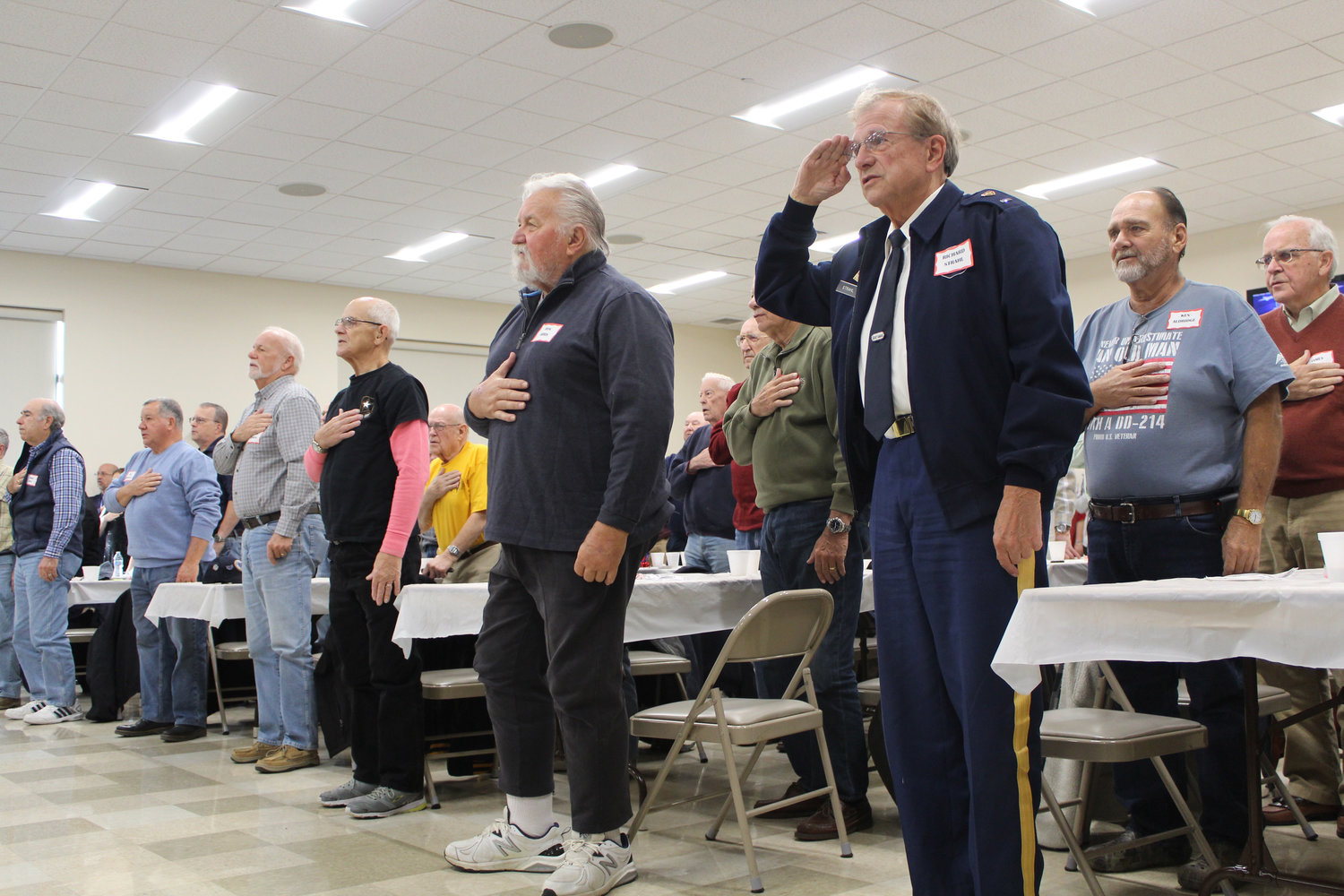 Army veteran Richard Strahl salutes the flag during the Pledge of Allegiance during Rep. Tom Mehaffie's Veterans Breakfast at the Lower Swatara Fire Hall Nov. 8.