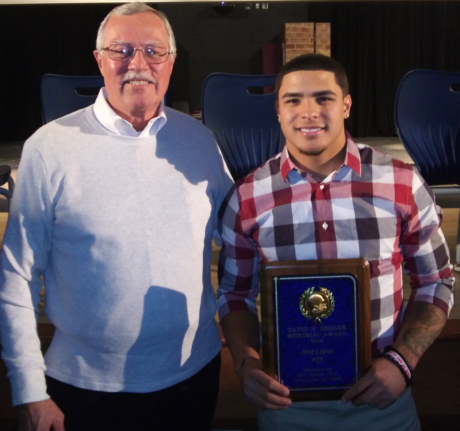 Press & Journal sports writer Larry Etter presented the Raider Club's annual David H. Degler Memorial Award to senior Jose Lopez at the football banquet that was held Sunday evening at the high school.