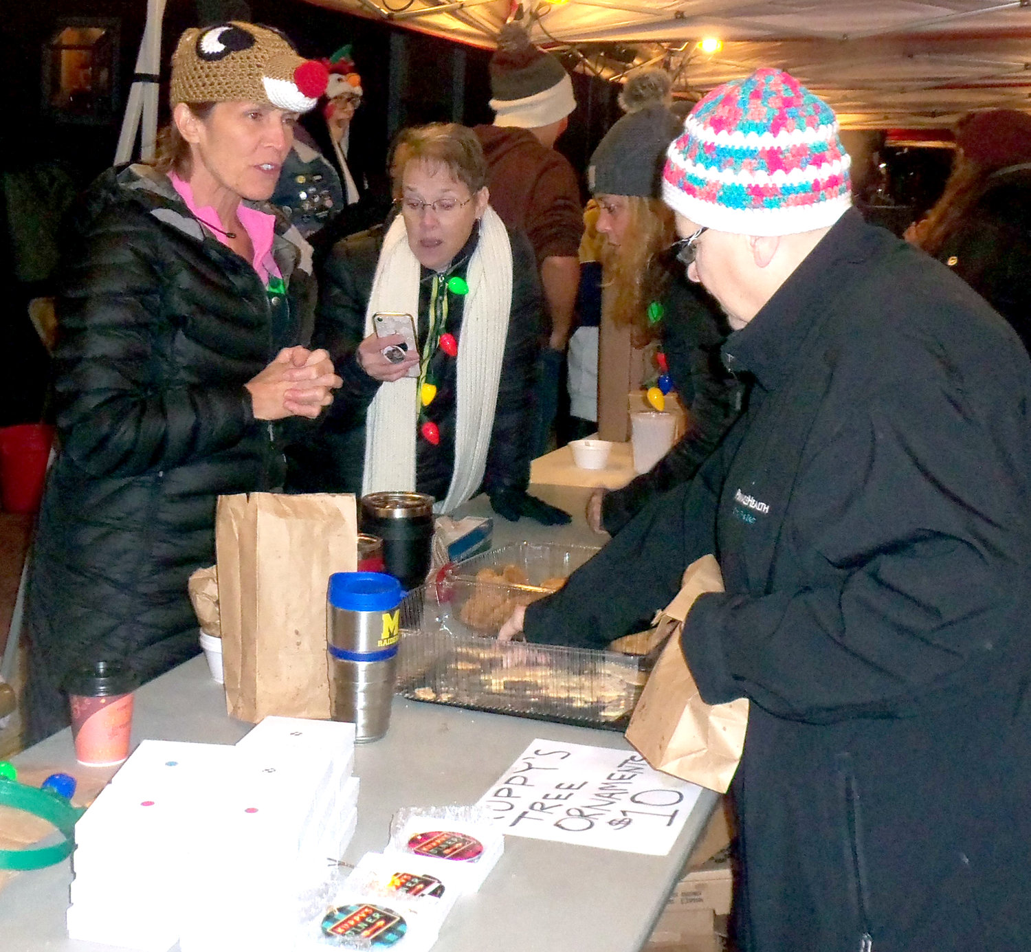 Kuppy's Diner co-owner Carol Kupp, left, and a Kuppy's crew of volunteers gave out free cookies, hot soup and hot coffee to the crowd at Middletown borough's Christmas tree-lighting ceremony Saturday, Nov. 30.