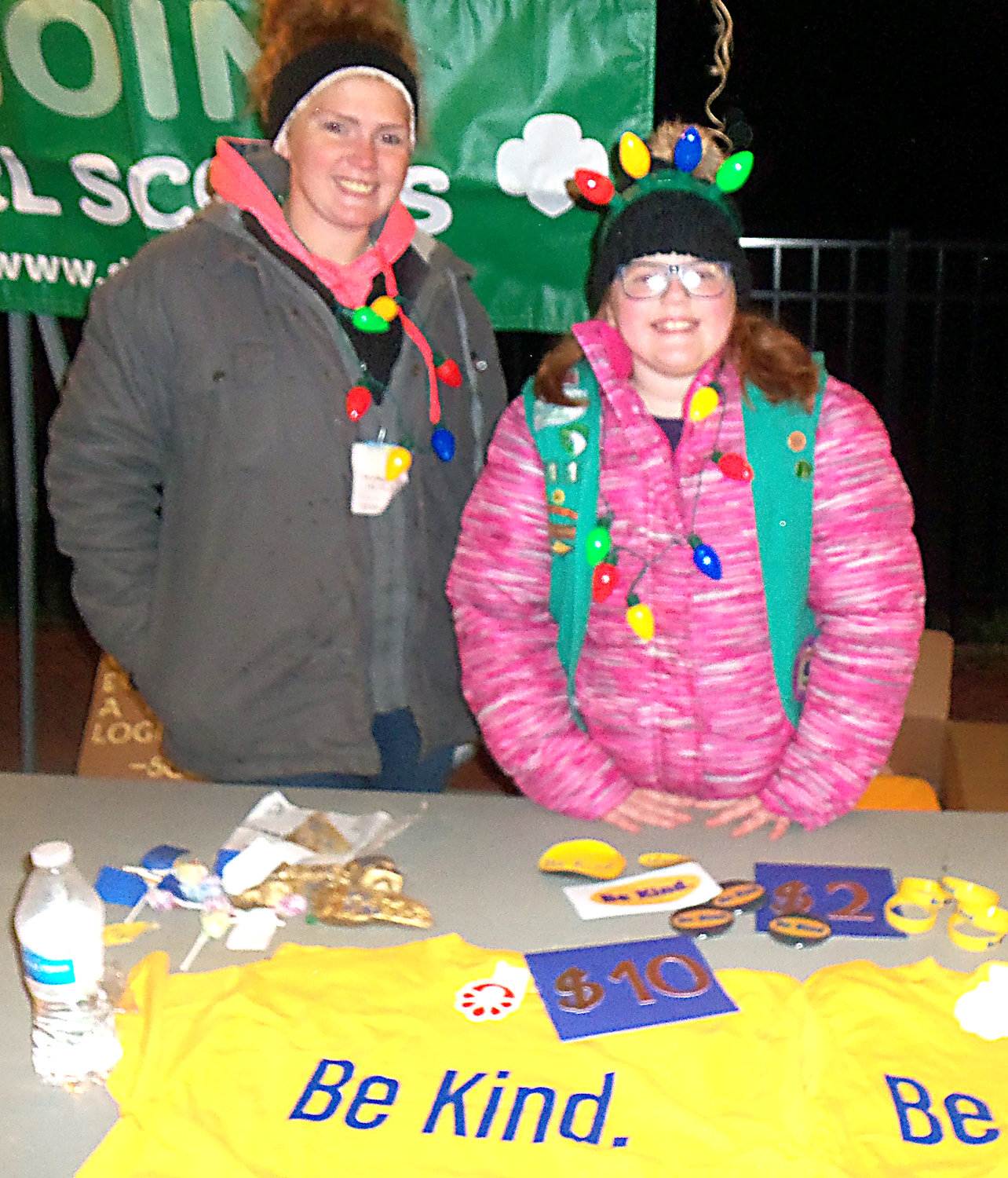 "Junior Girl Scout Troop No. 11113 was represented at Middletown borough's tree-lighting ceremony Saturday, Nov. 30, with a ""Be Kind"" vendor booth. ""Be Kind"" was the theme of the troop's recent Agent of Change project. Shown here are troop leader Katelynn Moyer and her daughter, Junior Girl Scout Ireland Moyer.."