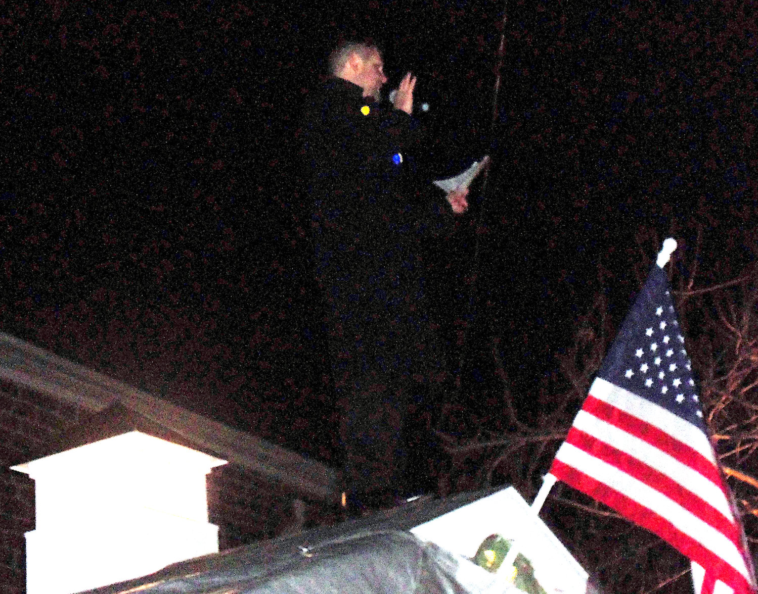 Mayor James H. Curry III addresses the crowd at Middletown borough's tree-lighting ceremony from the roof of the new Santa house just before it was unveiled Saturday, Nov. 30..