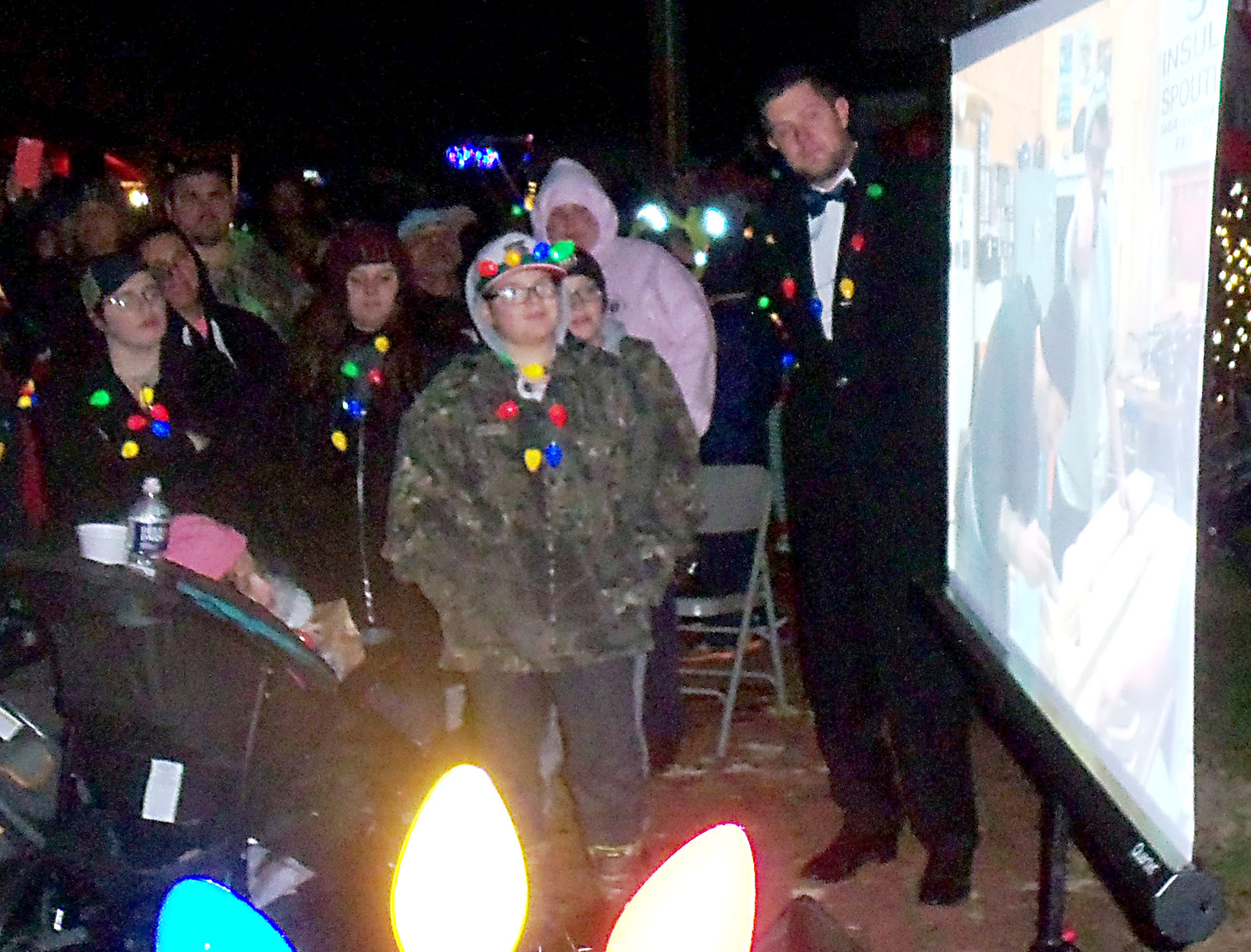 Mayor James H. Curry III shows a video about the new Santa house to the crowd at Middletown borough's tree-lighting ceremony on Saturday night, Nov. 30.