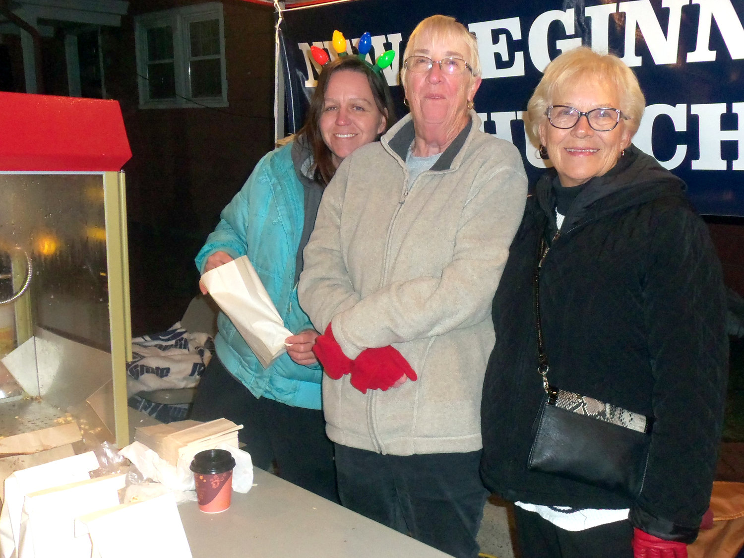 New Beginnings Church of Middletown warmed the crowd at Saturday's borough tree-lighting ceremony with free popcorn. Seen Nov. 30 from left are volunteers Liz Hicks, Pat Sprecher and Becky Smith.